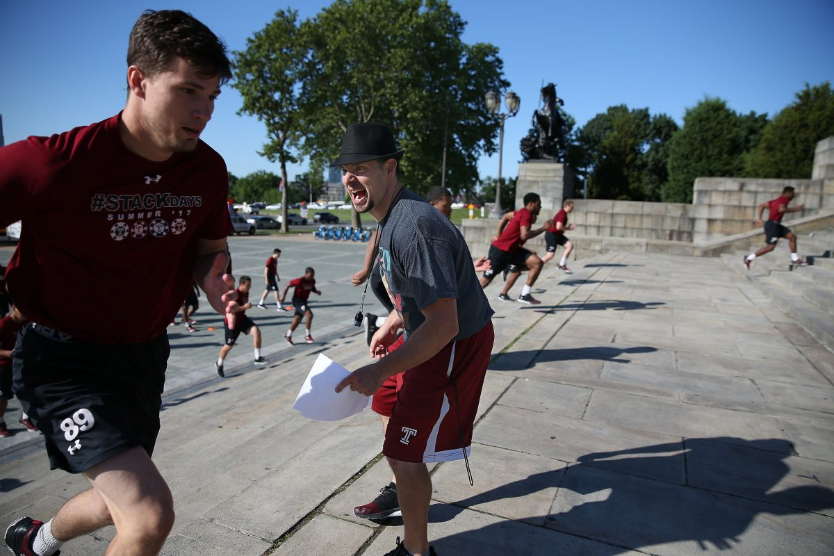 Strength and conditioning coach David Feeley (center) encourages the Temple football team as the players do a Rocky-like workout on the Art Museum steps.