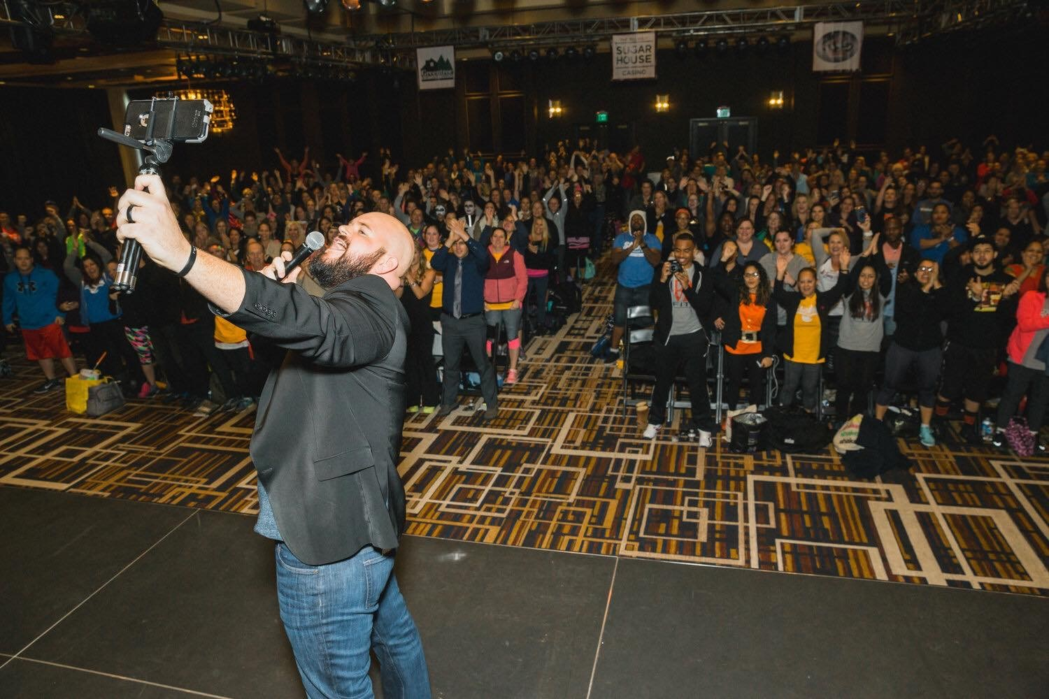 Dave McClain stands onstage at a Beachbody event in Philadelphia.
