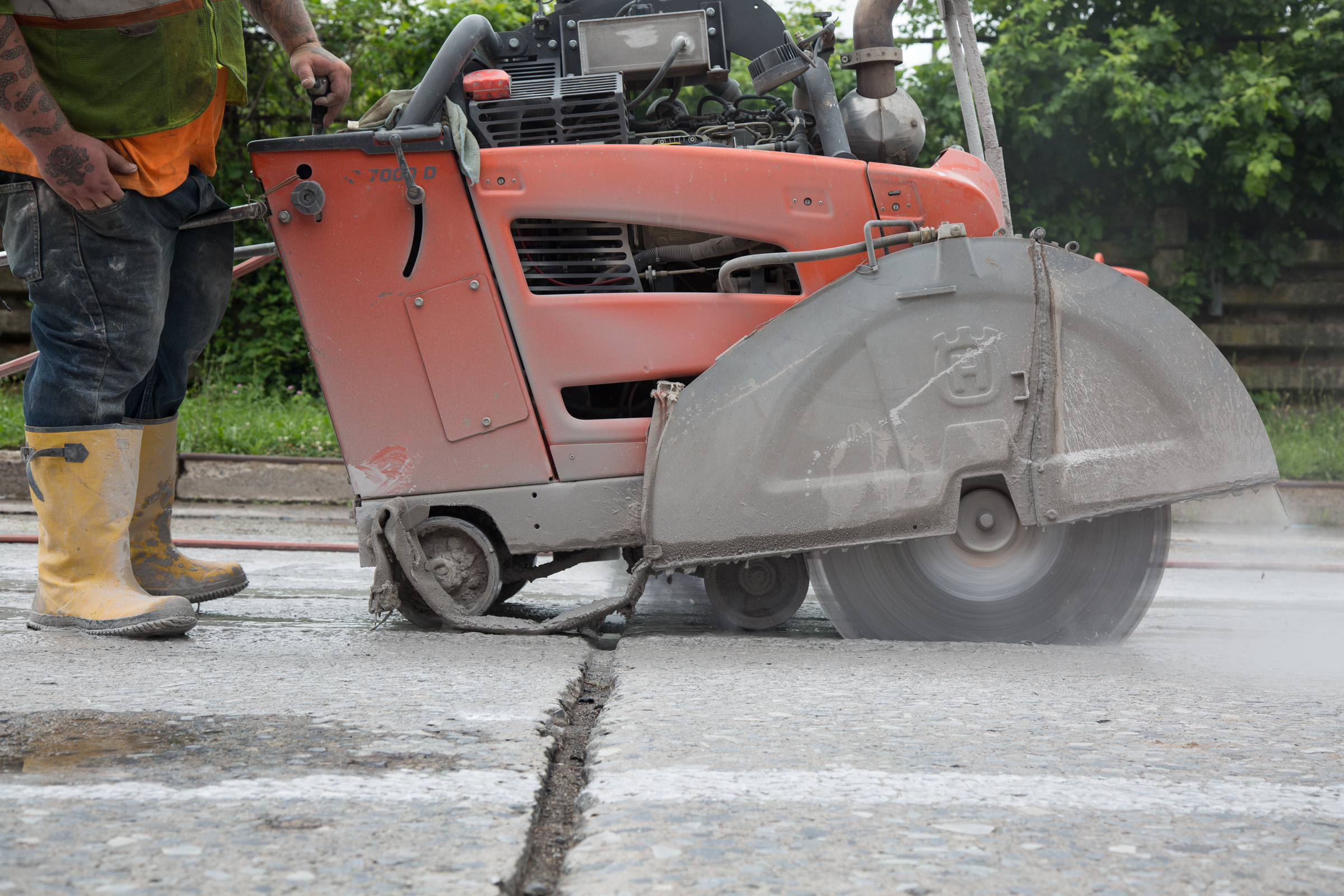 Workers cut the concrete pavement before excavating a trench for a new Peco gas main in Norristown.
