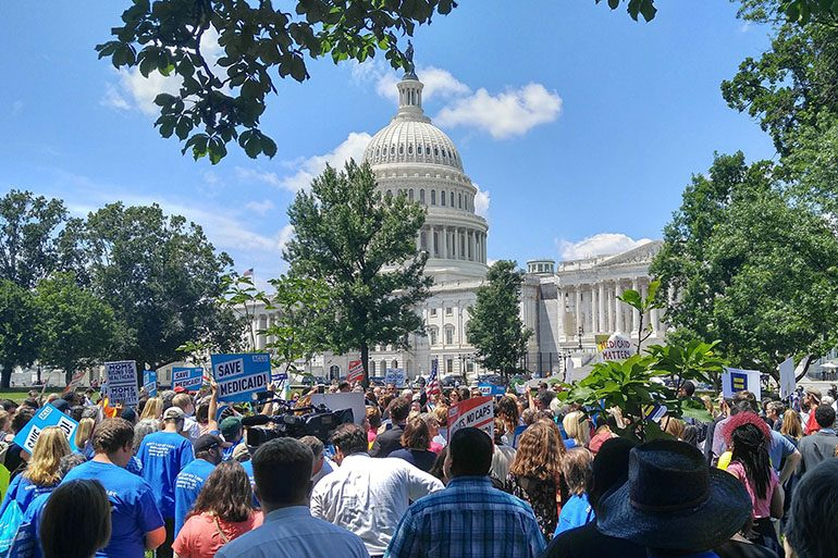 Medicaid has strong supporters, as seen in this rally last year. A controversial proposal on the program could be a smart political compromise.