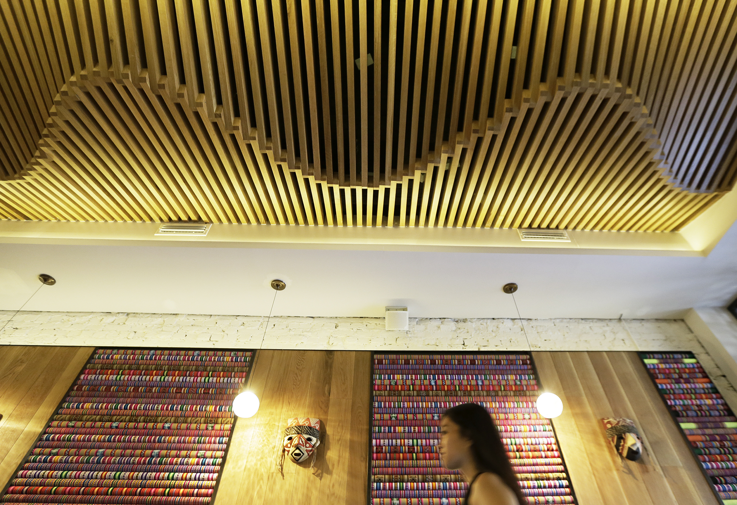 The undulating wood ceiling and fabric walls in the bar area at Vista Peru evoke signature images of the South American country.