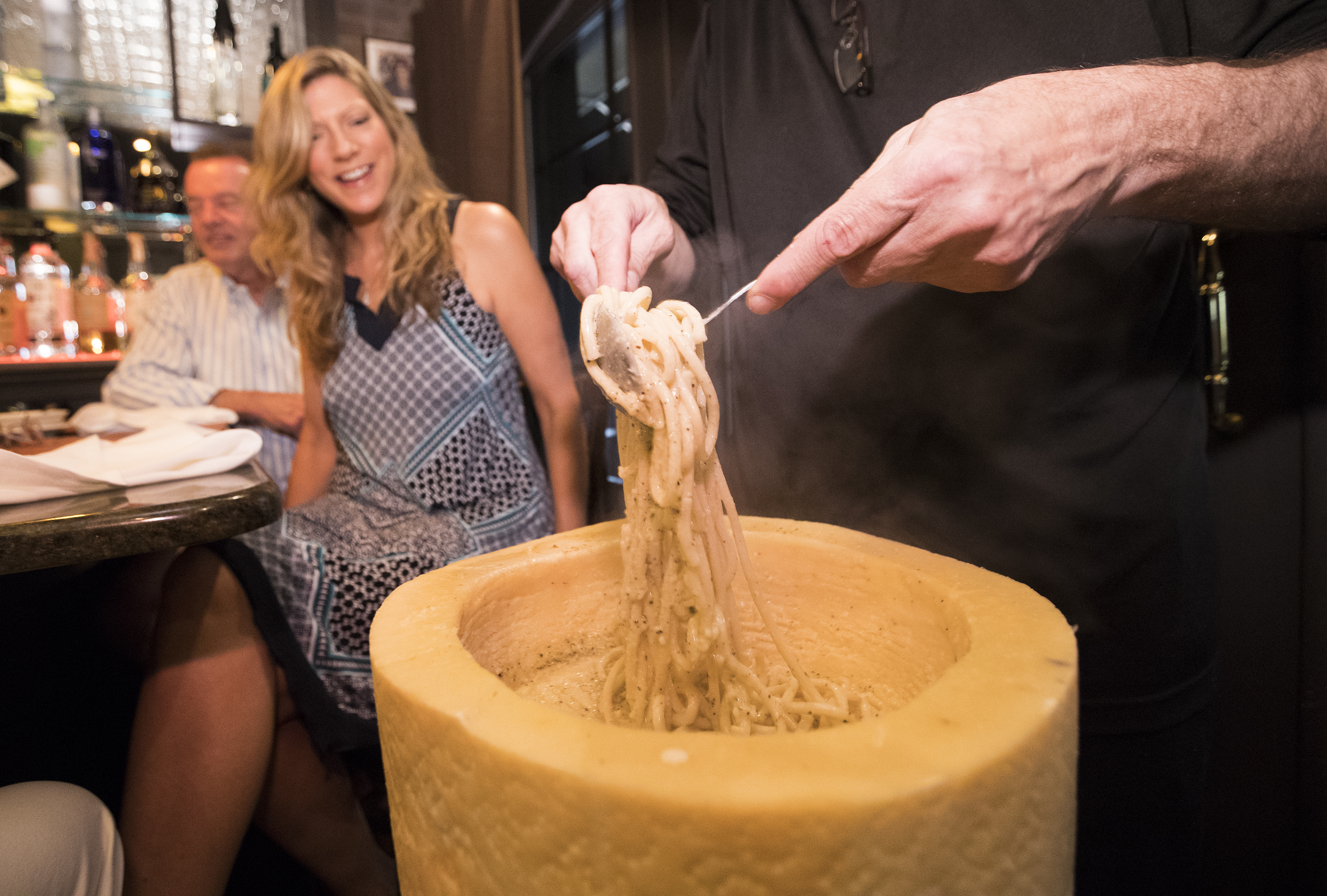 Freshly prepared pasta is gently tossed into a wheel of Pecorino to make cacio e pepe at Cafe 2825 in Atlantic City.