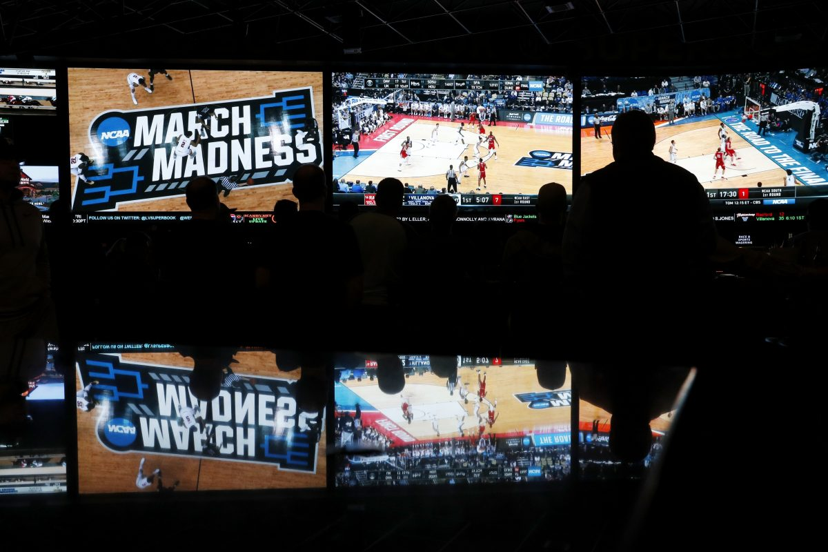 People watch coverage of the NCAA basketball tournament at the Westgate Superbook sports betting casino in Las Vegas.