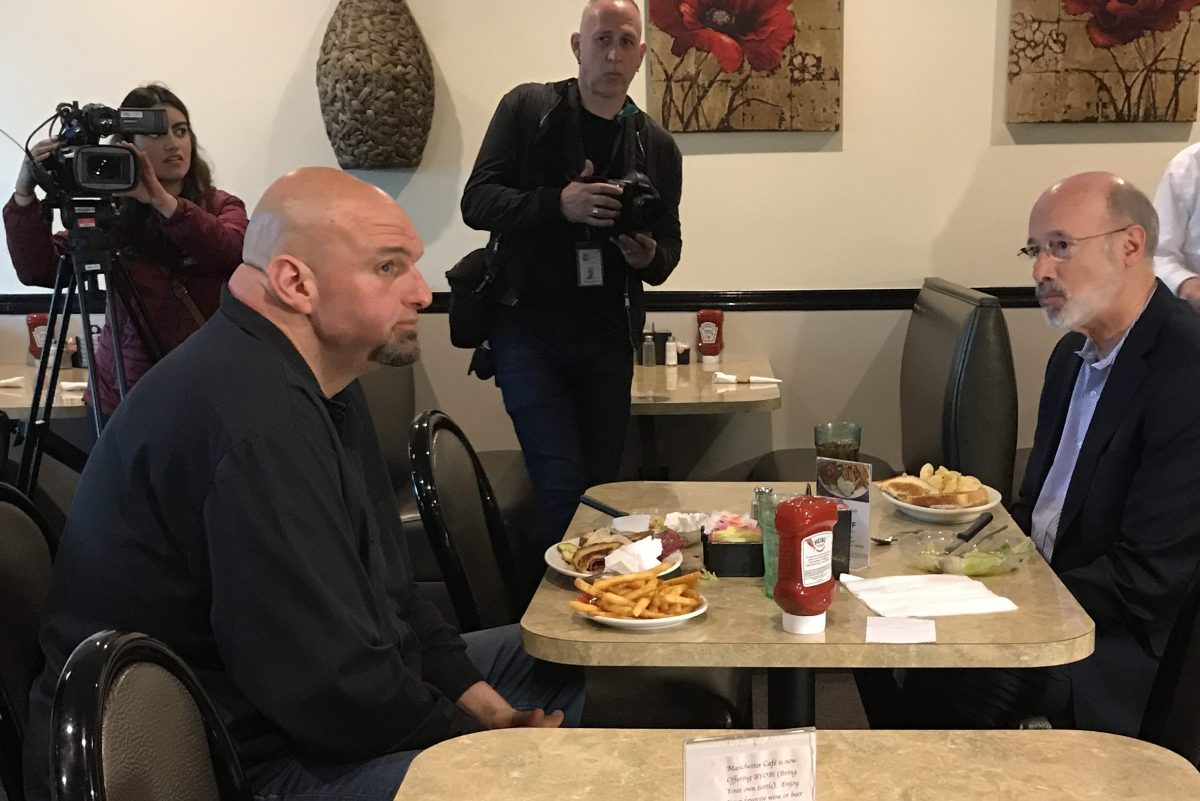 New Democratic nominee for lieutenant governor, Braddock mayor John Fetterman, meets the top of the ticket, Gov. Wolf, at a diner in Manchester, Pa. Wednesday.