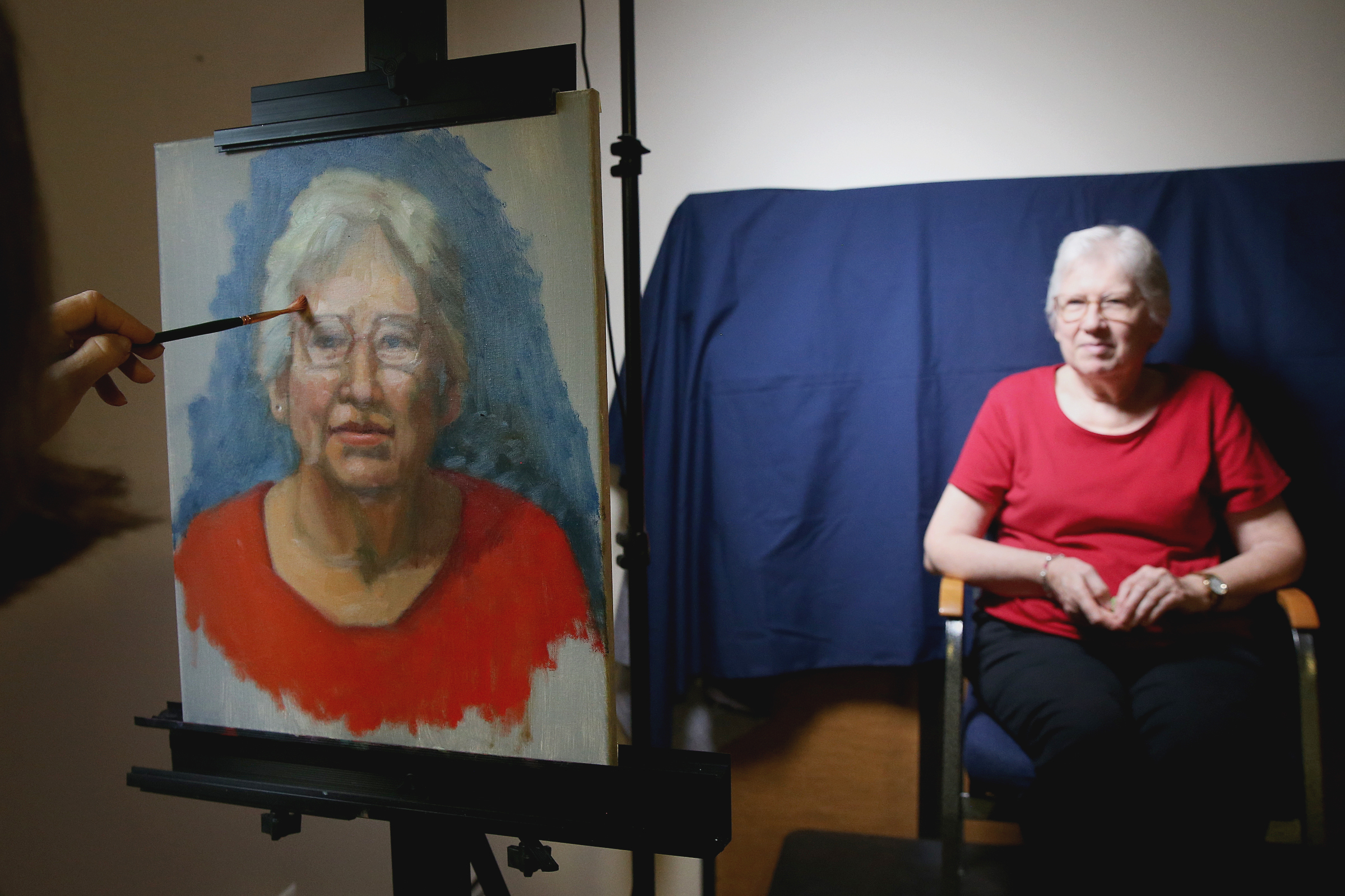 Linda Dennin, left, paints Maryann Lutringer at St. Peter Roman Catholic Church´s senior ministry program in Merchantville, N.J. Dennin is painting 55 portraits, which will be displayed in the dining room.