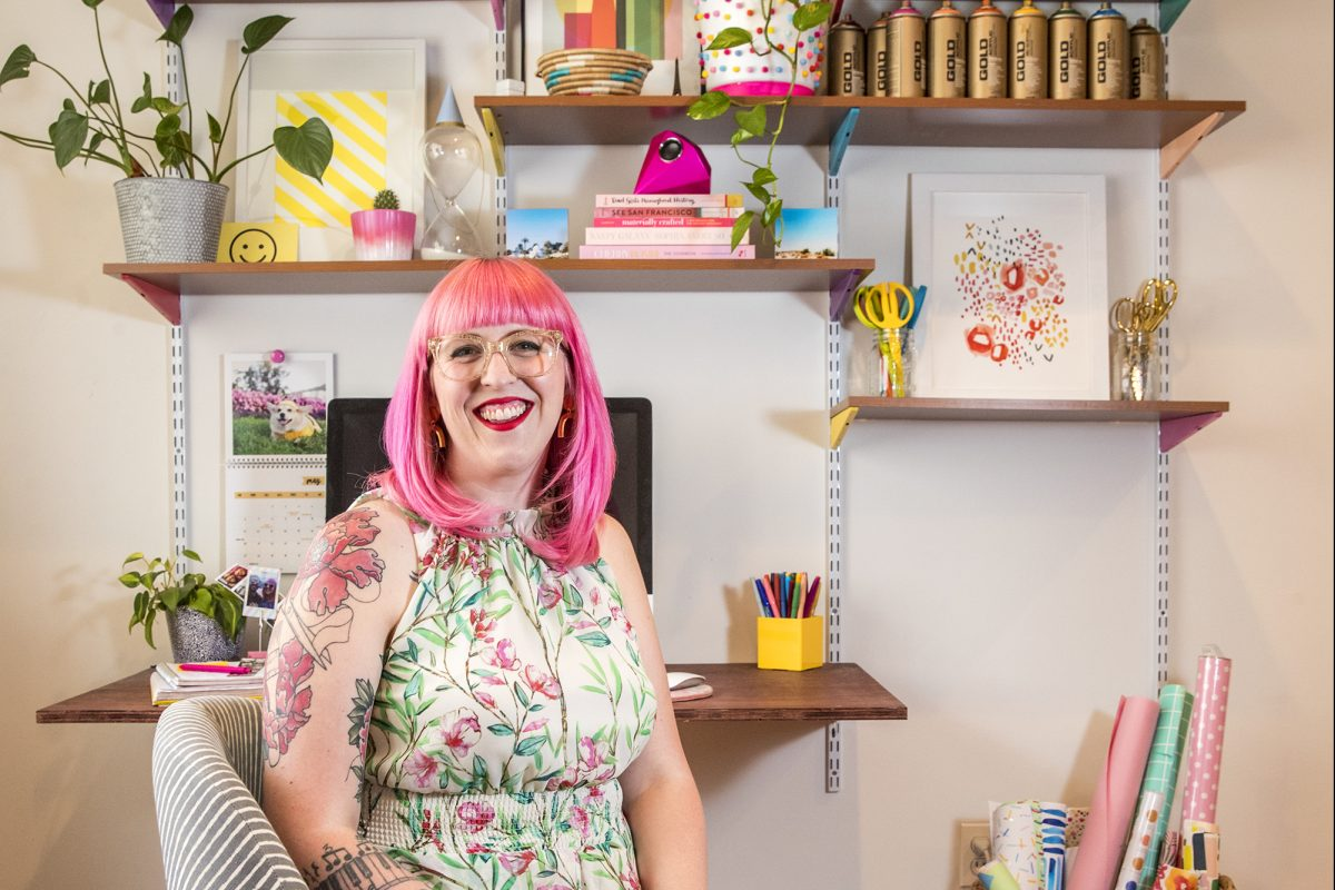 Rachel Mae Smith, a South Philly-based star blogger, sits in front of her color-coordinated work desk at her home in South Philadelphia.
