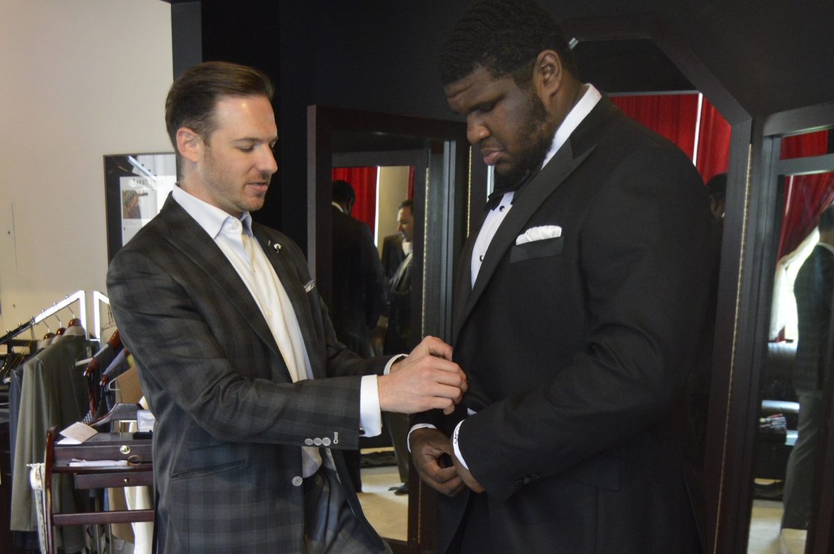 "Brian Lipstein, owner of Rittenhouse Square´s Henry A. Davidsen, completes Justin ""Big Fresh"" Johnson´s final fitting for his tuxedo."