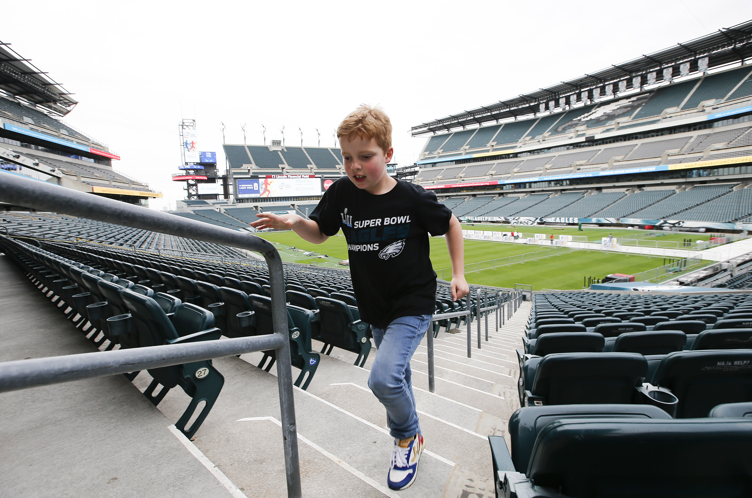 Thijmen Hendriks, 8, runs up the stairs inside Lincoln Financial Field on Friday, May 18, 2018.
