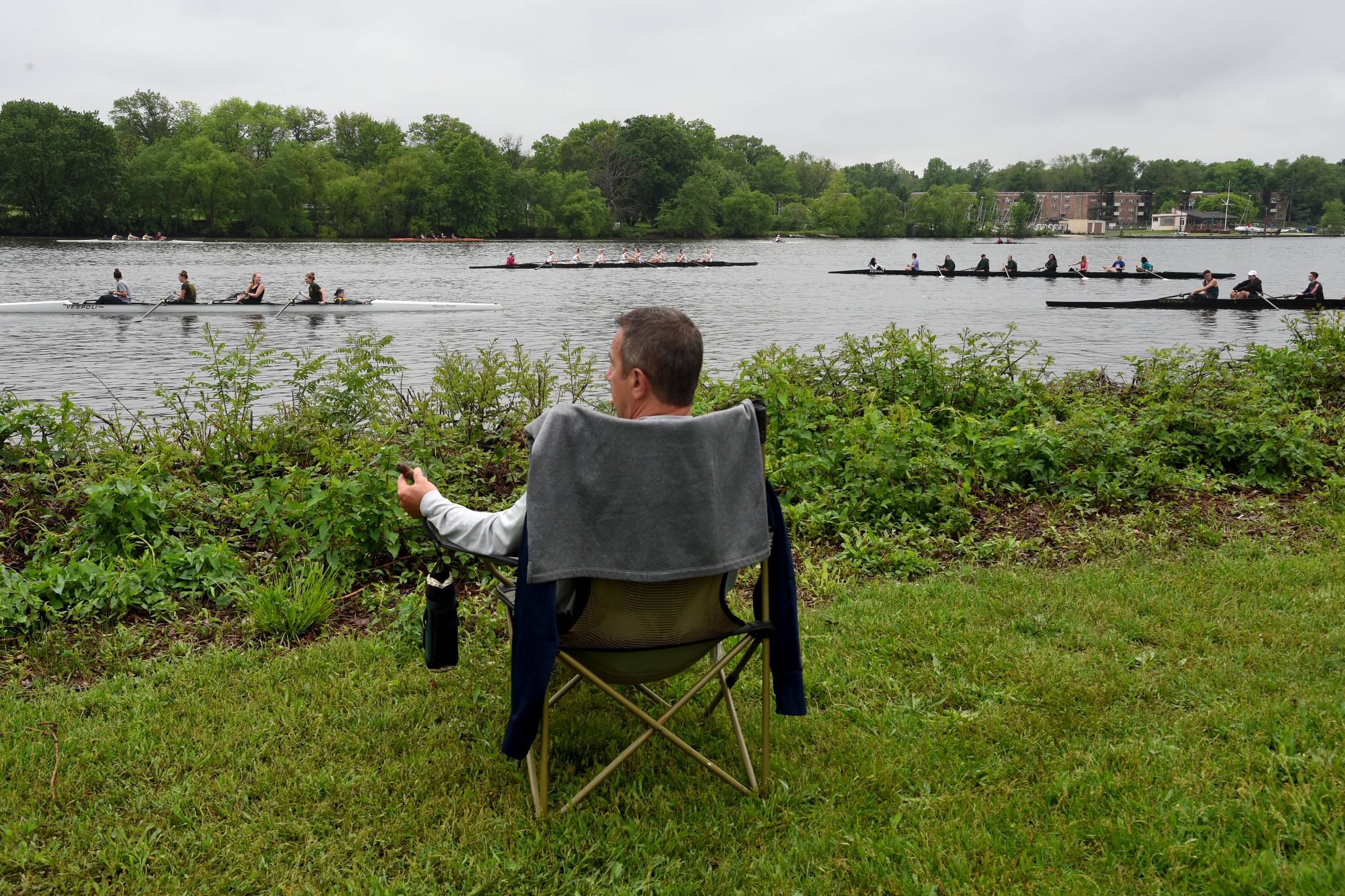 Joe Haney, a coach with St. Augustine Prep, watches rowers  practicing on the Cooper River Thursday.