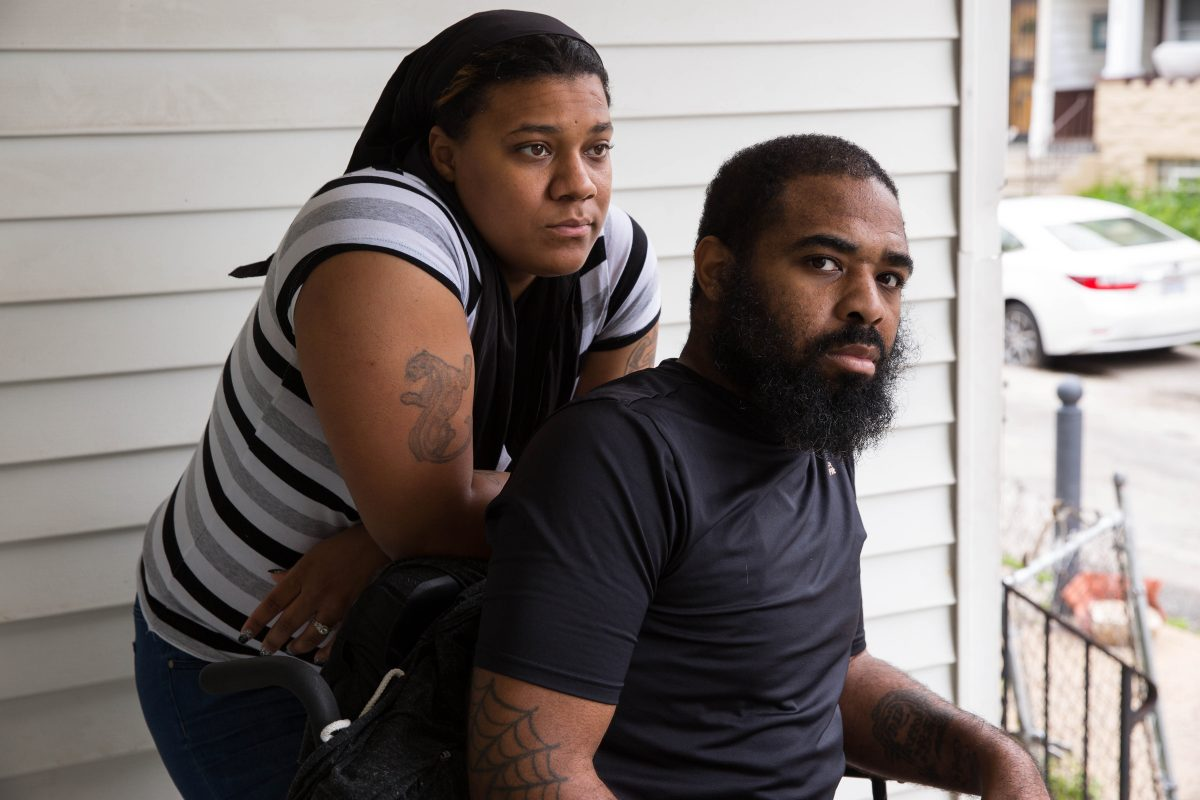 Tamira Brown and Jalil Frazier on the front porch, where steep stairs leading to the sidewalk pose a major obstacle for Jalil.