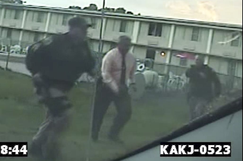 Former Bordentown Police Chief Frank Nucera Jr., (pink shirt) is seen on police dashcam responding to a 9-1-1 call at a motel in September 2016. Nucera, who faces a federal hate trial, is accused of assaulting a young black man at the motel during an arrest.