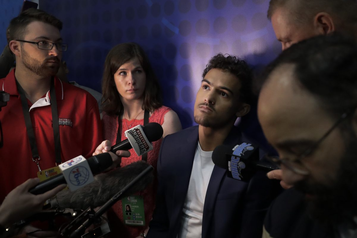 Trae Young (center) met with the Sixers on Friday.