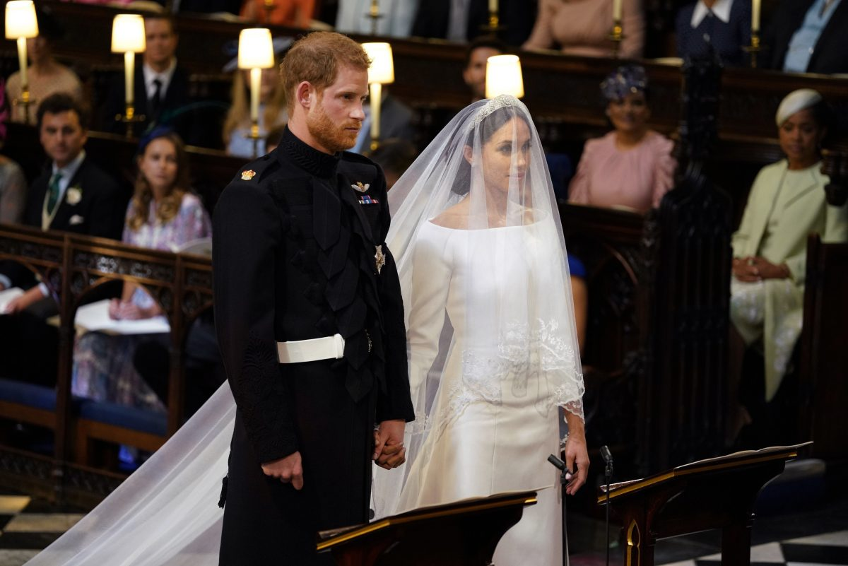 Britain´s Prince Harry and Meghan Markle stand, prior to the start of their wedding ceremony, at St. George´s Chapel in Windsor Castle in Windsor, near London, England, Saturday, May 19, 2018. (Dominic Lipinski/pool photo via AP)