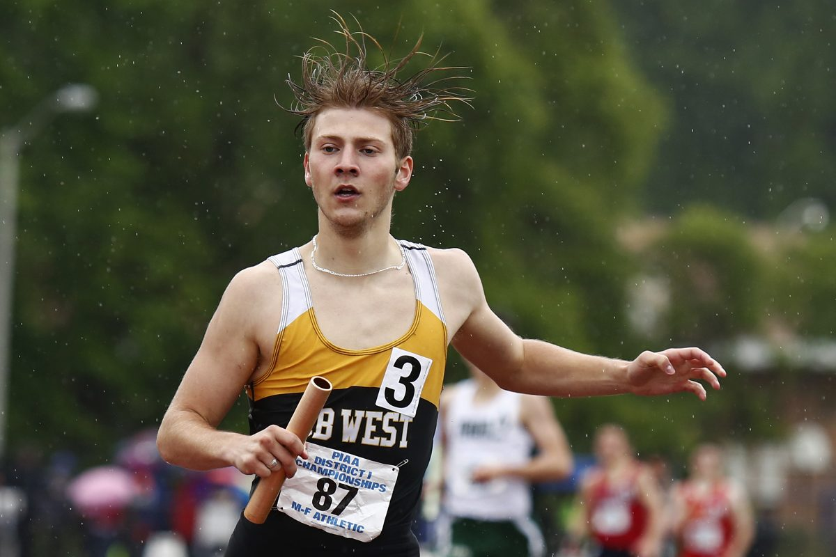Brian Baker of Central Bucks West completes the anchor leg as the Bucks win the 4×800-meter relay in Class 3A at the PIAA District 1 track and field championships on Saturday at Coatesville.