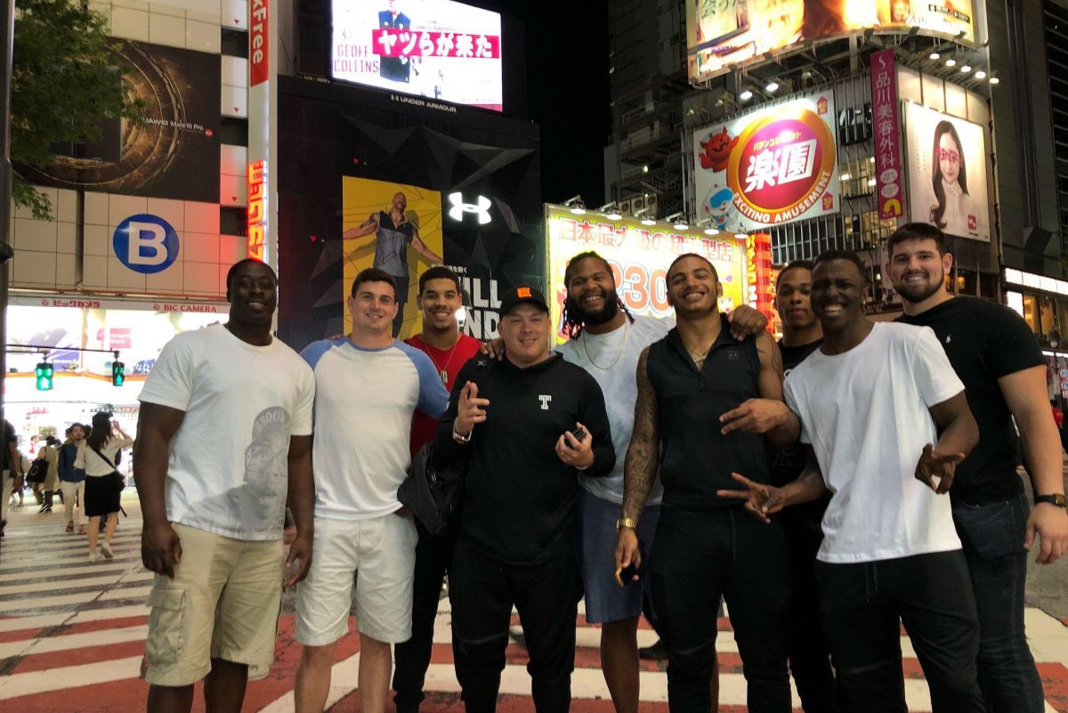 Temple Football players and coach Geoff Collins in Japan