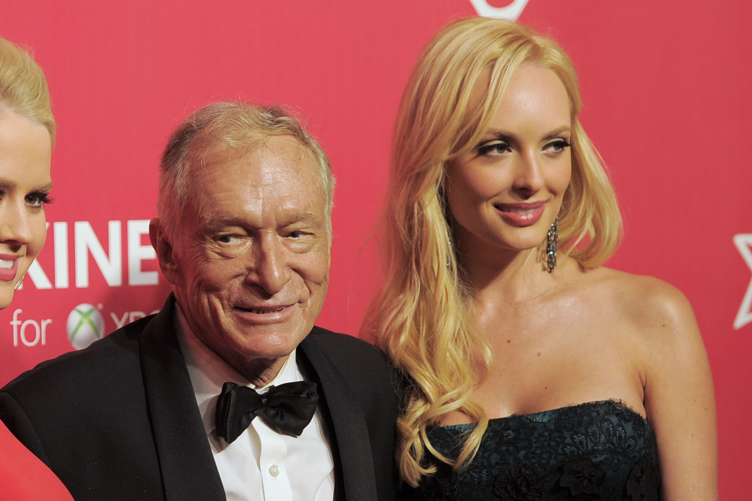 Hugh Hefner, center, Anna Sophia Berglund, left, and Shera Bechard arrive at the MusiCares Person of the Year gala honoring Paul McCartney on Friday, Feb. 10, 2012 in Los Angeles. CHRIS PIZZELLO / AP