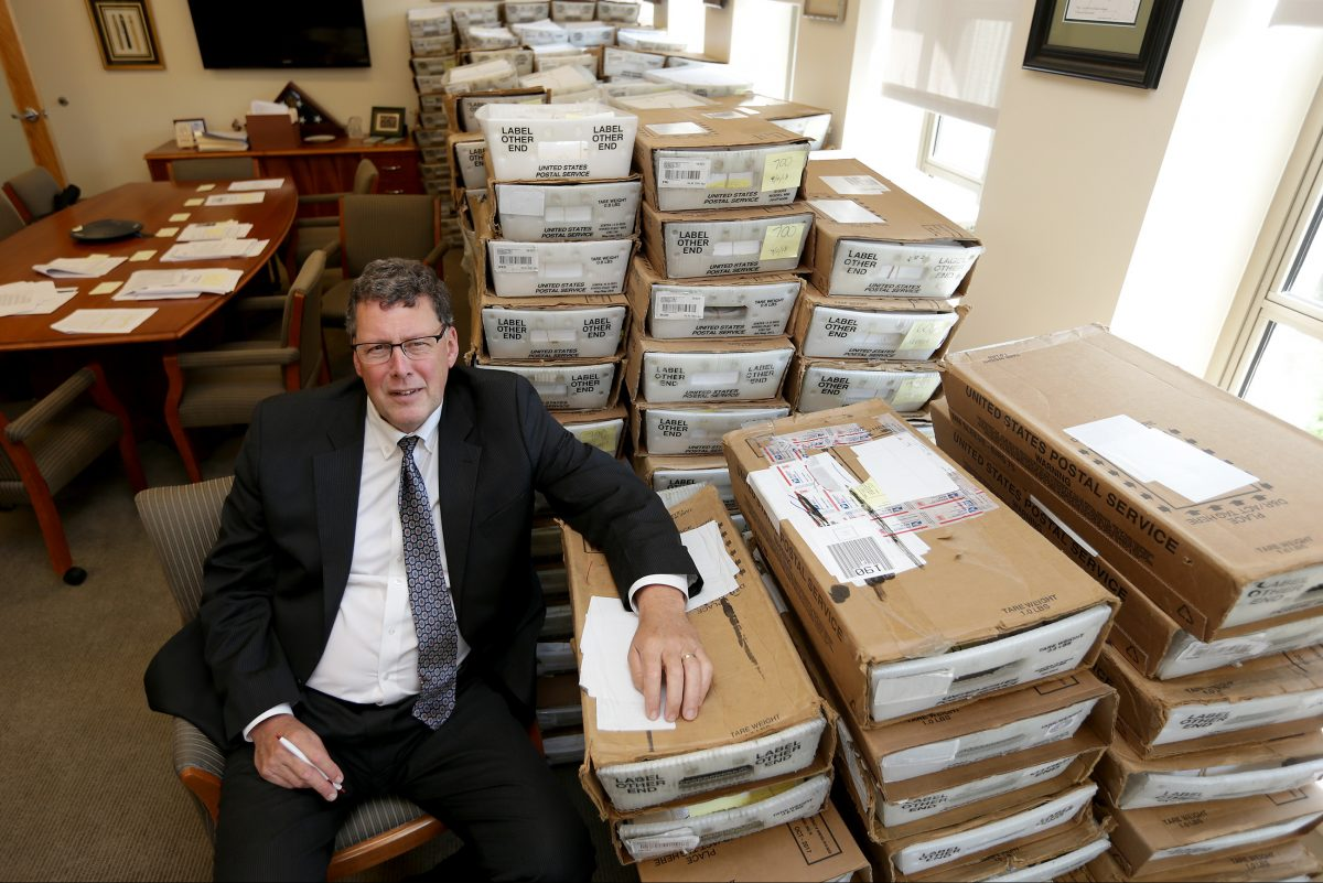 Scott Petri, who is the head of the PPA, sits in his office with boxes of returned mail from the parking ticket amnesty program in Philadelphia. Petri estimates more than  300,000 piece of mail were returned.