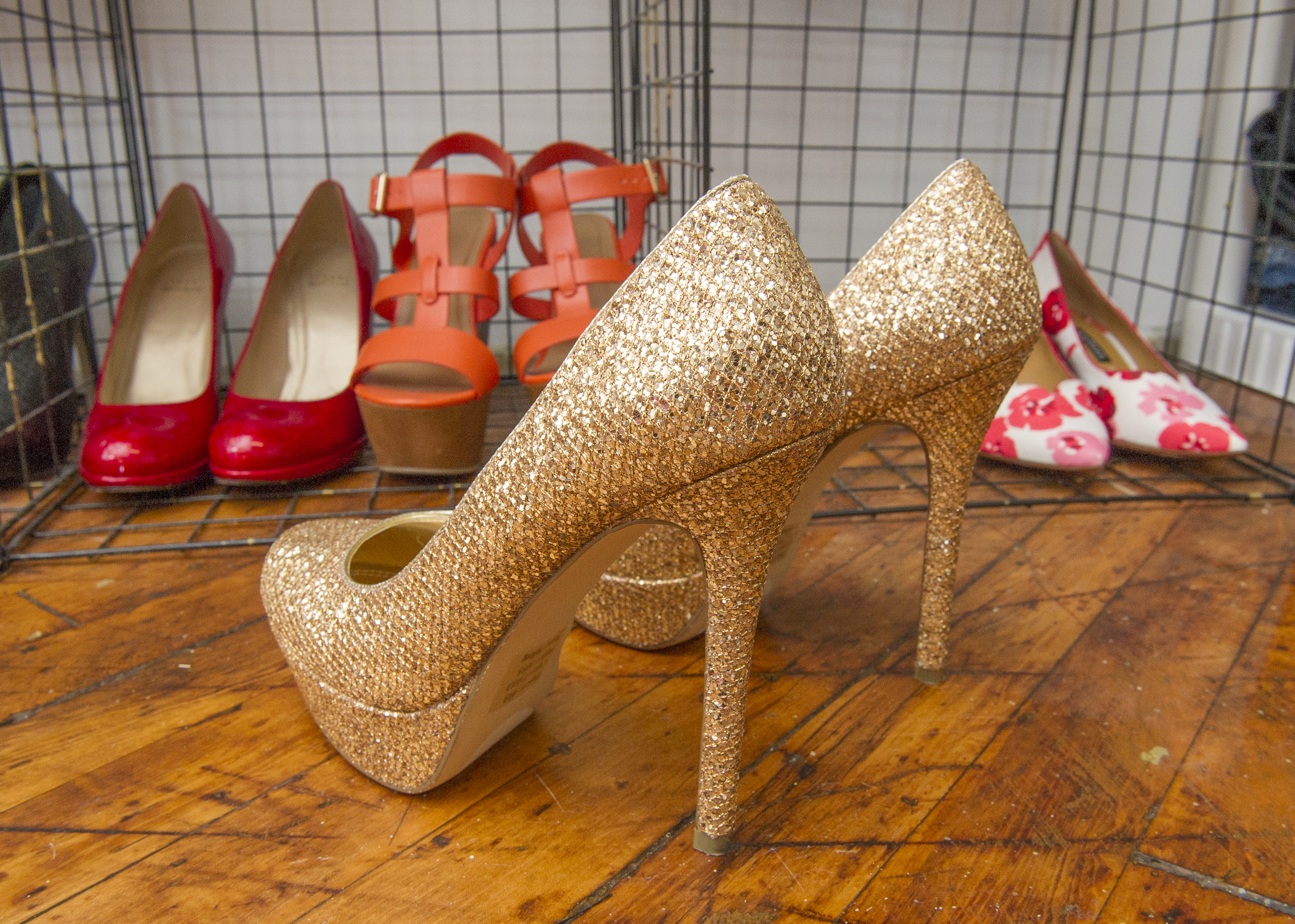 EWGEVOLVE23-g.Gold stilettos for sale at And We Evolve. (Jonathan Wilson / For the Inquirer)