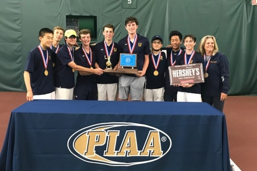 The Unionville boys' tennis team poses with its hardware after winning the PIAA Class 3A championship.