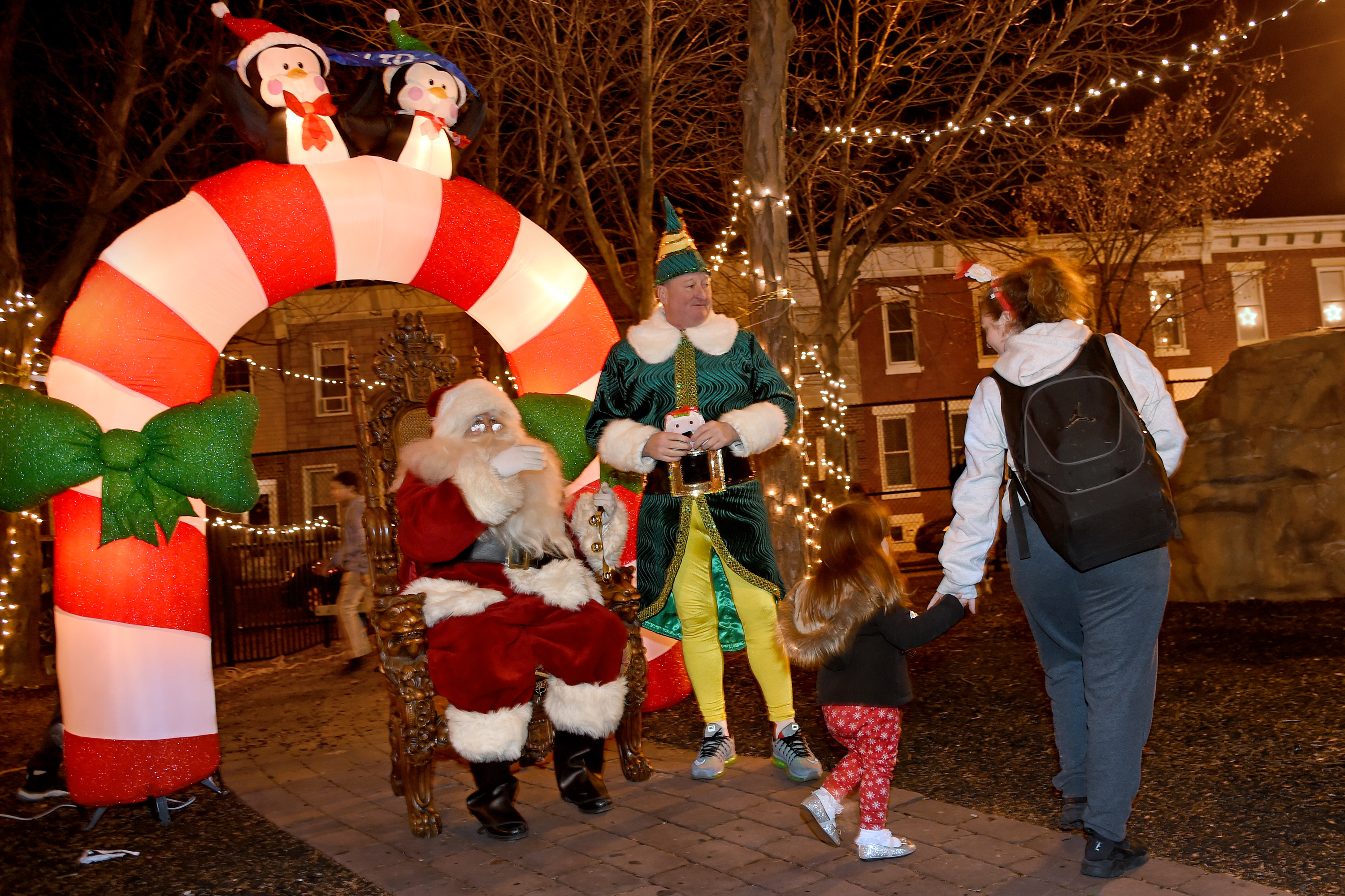Mayor Kenney gives out toys to the children in his childhood Burke Playground at 2nd and Jackson Streets as he makes his annual holiday appearance as Buddy the Elf (with Councilman Mark Squilla as Santa) in his old South Philadelphia neighborhood December 19, 2017.
