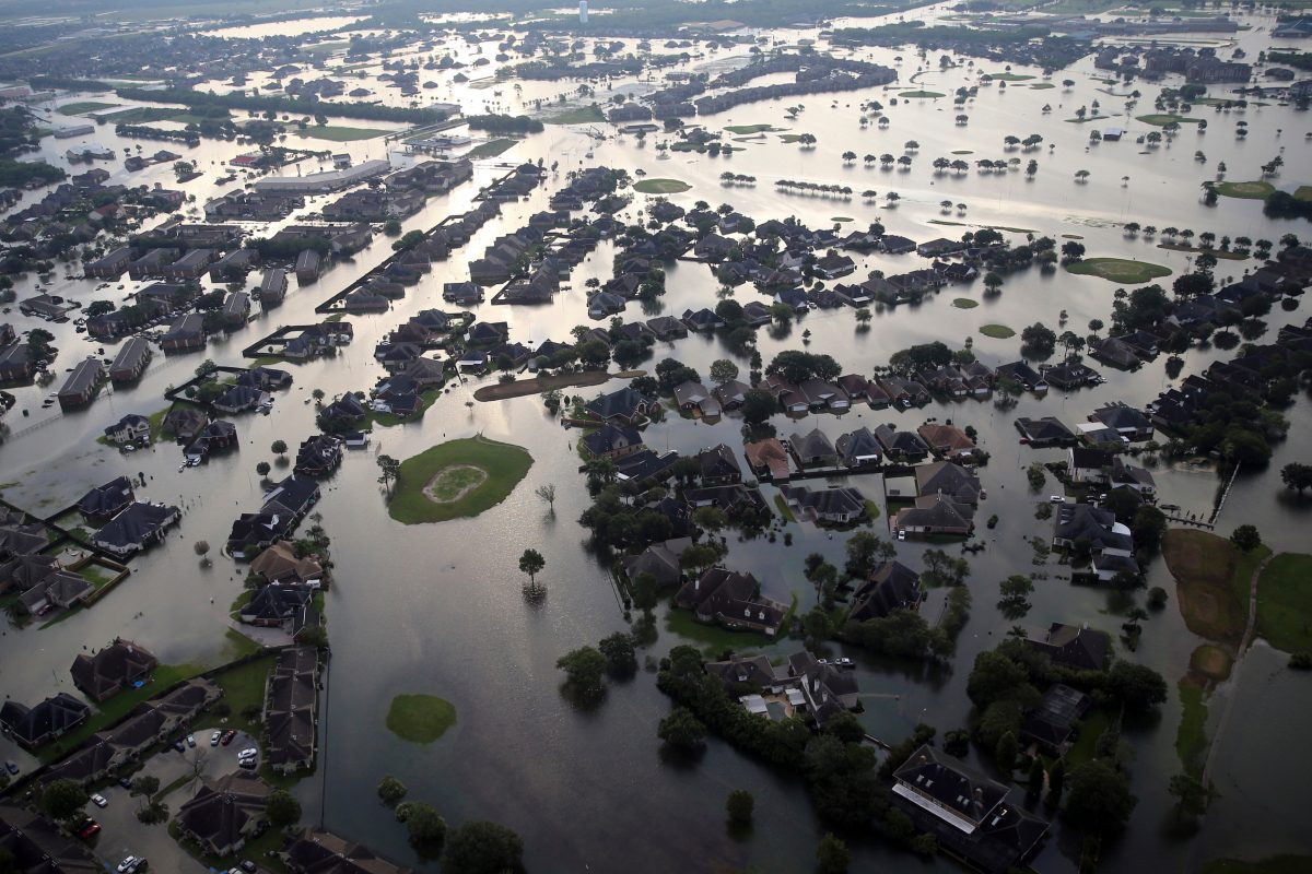 Floodwaters from Tropical Storm Harvey surround homes in Port Arthur, Texas, last August. 14 named storms; 7 hurricanes; 3 majors.