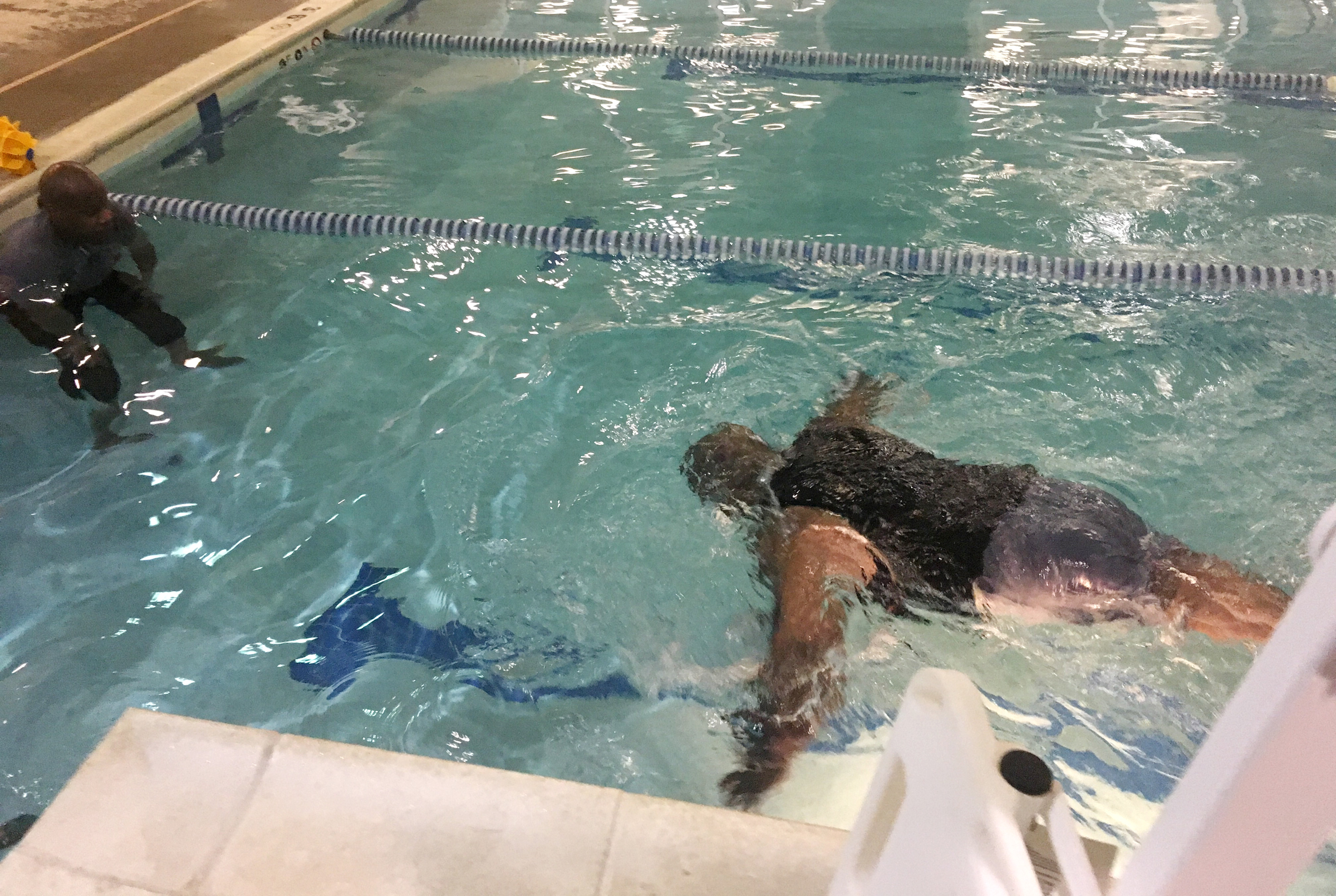 Former Temple basketball player Ron Rollerson, whose leg was amputated in 2016, working out in a pool. He has a new goal, swimming in the 2024 Paralympics. MIKE JENSEN / Staff