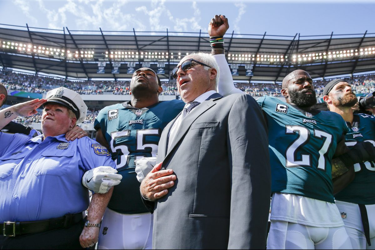 Malcolm Jenkins (right) raising his first as a form of protest during the national anthem before a September game against the Giants alongside Eagles owner Jeffrey Lurie and defensive end Brandon Graham.
