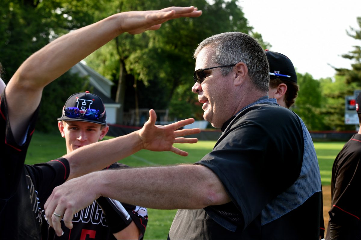 Haddonfield baseball coach Bob Bickel is congratulated by his players on Wendesday after his 300th win and a Colonial Conference title.