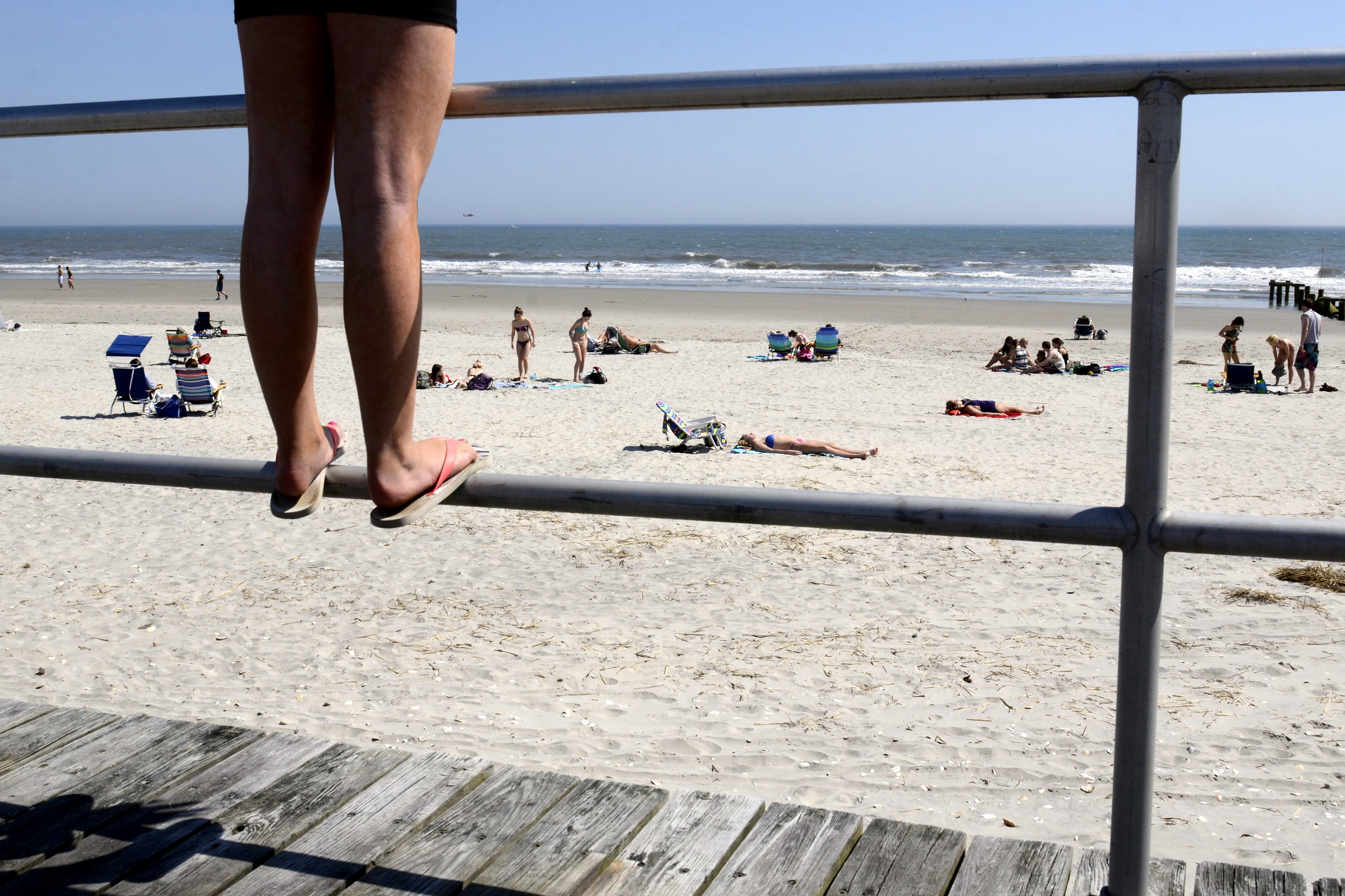 Twelve year-old Madison Hollingsworth stands on the boardwalk railing in Ocean City, as she visits the Jersey shore from Clementon, with her mother and mom-mom April 10, 2013 TOM GRALISH / Staff Photographer
