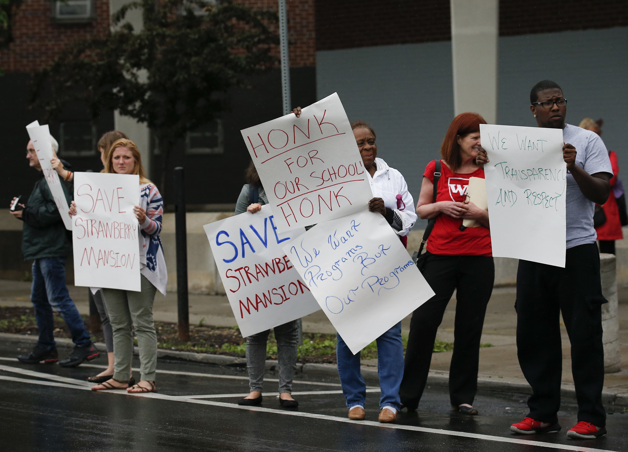 Demonstrators protest to call on the School Reform Commission to halt plans to phase out Strawberry Mansion High School.