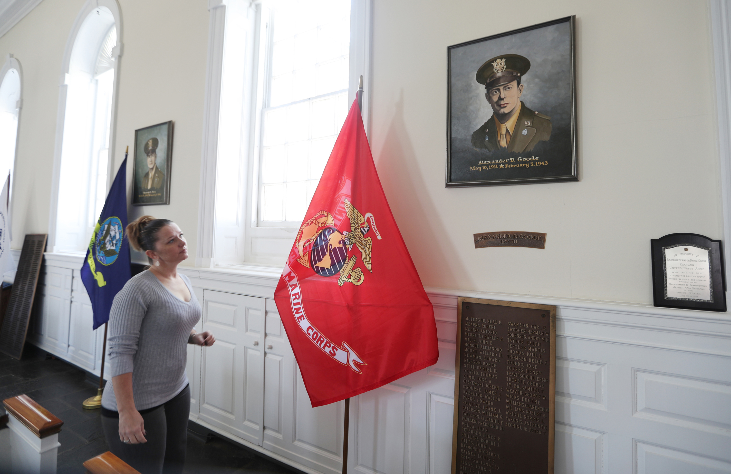 Executive Director Christine M. Beady looks at a painting of Rabbi Alexander D. Goode at the Chapel of the Four Chaplains at the The Navy Yard.