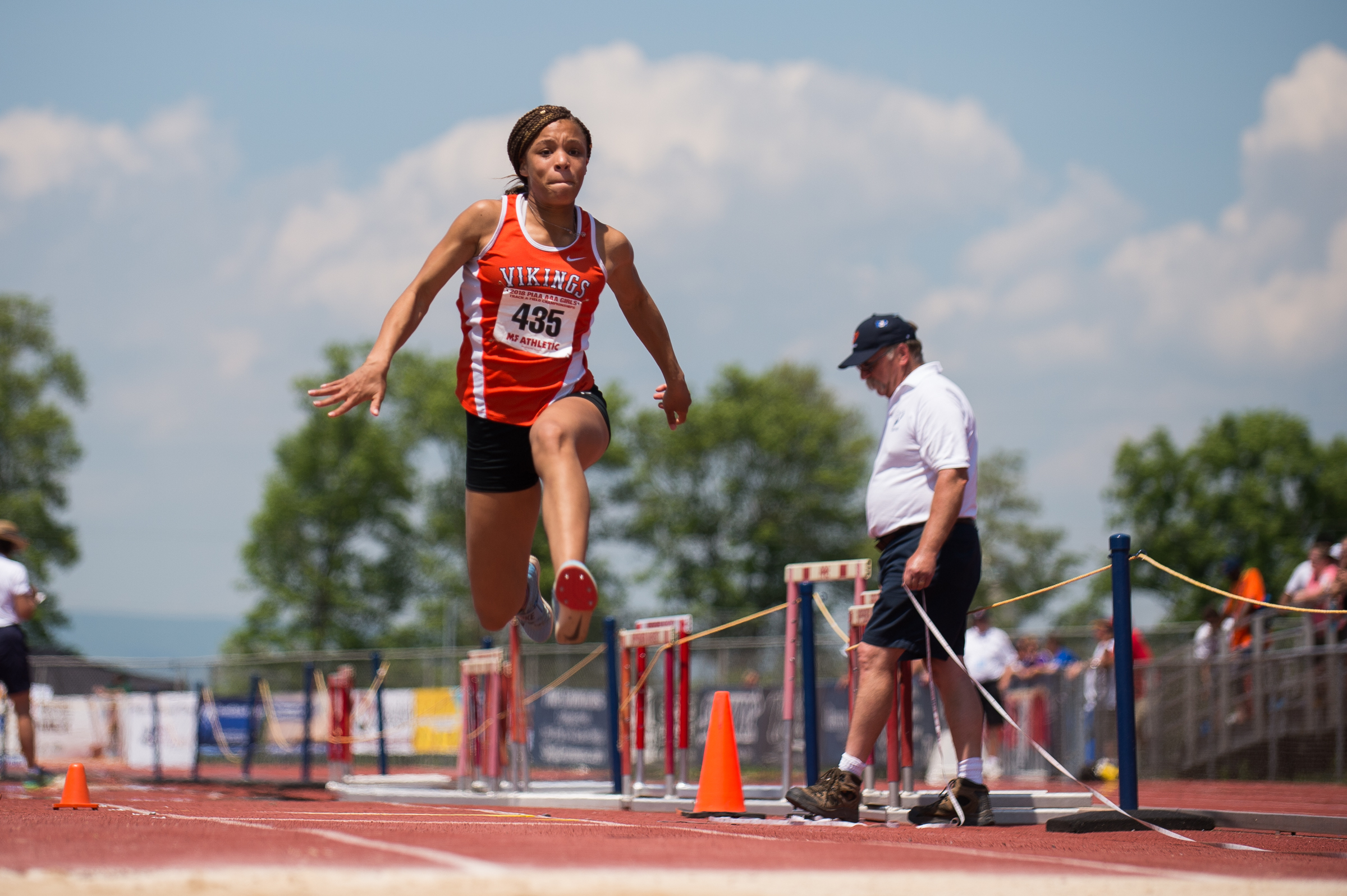 Christina Warren of Perkiomen Valley takes her final jump in the 3A long jump.