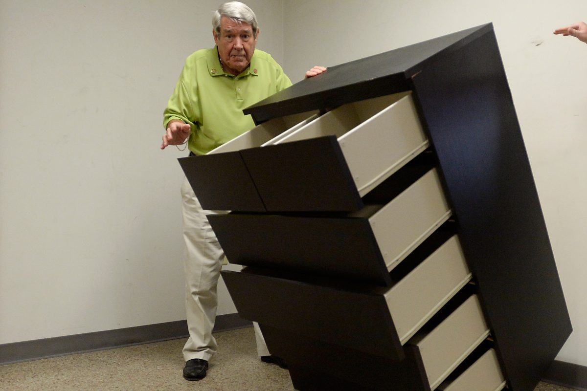 Bobby Puett, president of Diversified Testing Labs, watches as the Ikea Malm six drawer dresser falls over during a tip over test at Diversified Testing Labs in Burlington, North Carolina, September 17, 2015. The dresser failed the test of staying upright when all six drawers were open and no additional weight was added. The dresser also failed the test when any one drawer was open and an additional fifty pound weight was added. Puett says the Ikea Malm dresser does not meet the standards of safety.