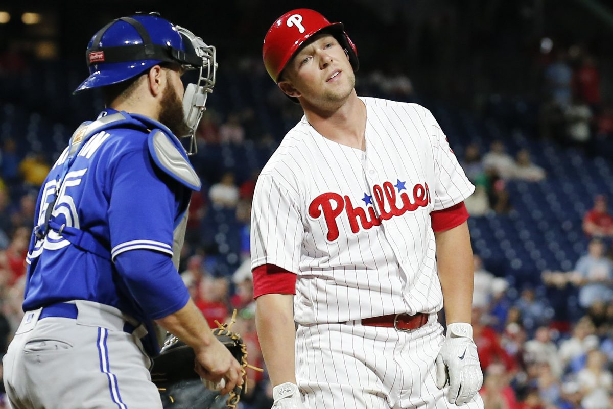 Phillies Rhys Hoskins reacts to a called strike three in the bottom of the ninth inning of the Phillies' 6-5 loss to the Blue Jays on Friday.