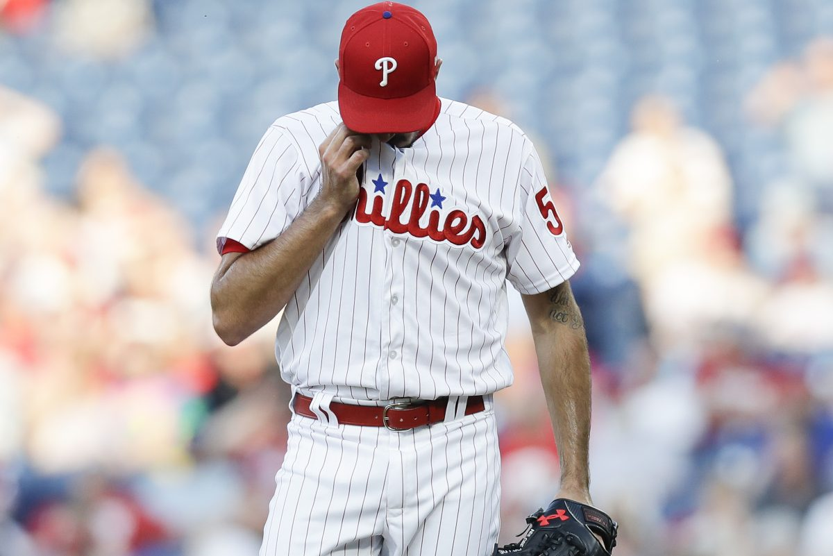 Phillies pitcher Zach Eflin wipes his face after the Toronto Blue Jays scored three runs in the first-inning on Friday, May 25, 2018 in Philadelphia.