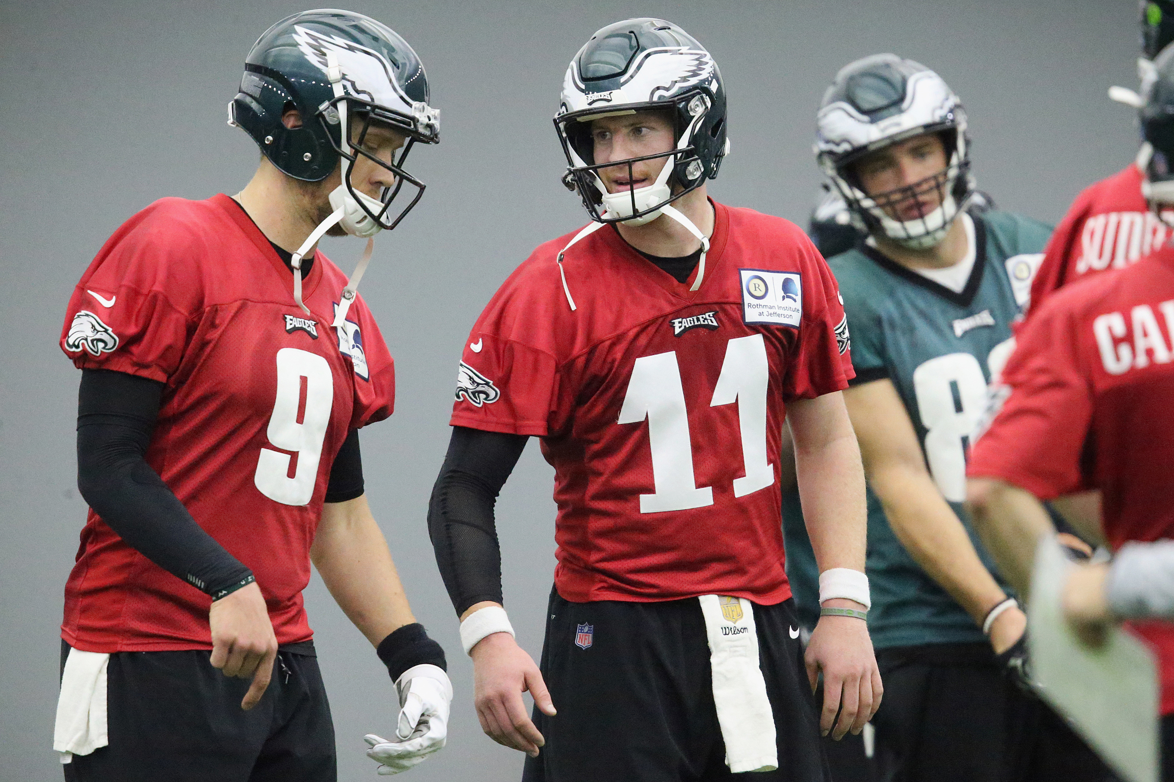 Backing up Carson Wentz (right) is a much better gig for Nick Foles (left) than babysitting Baker Mayfield.