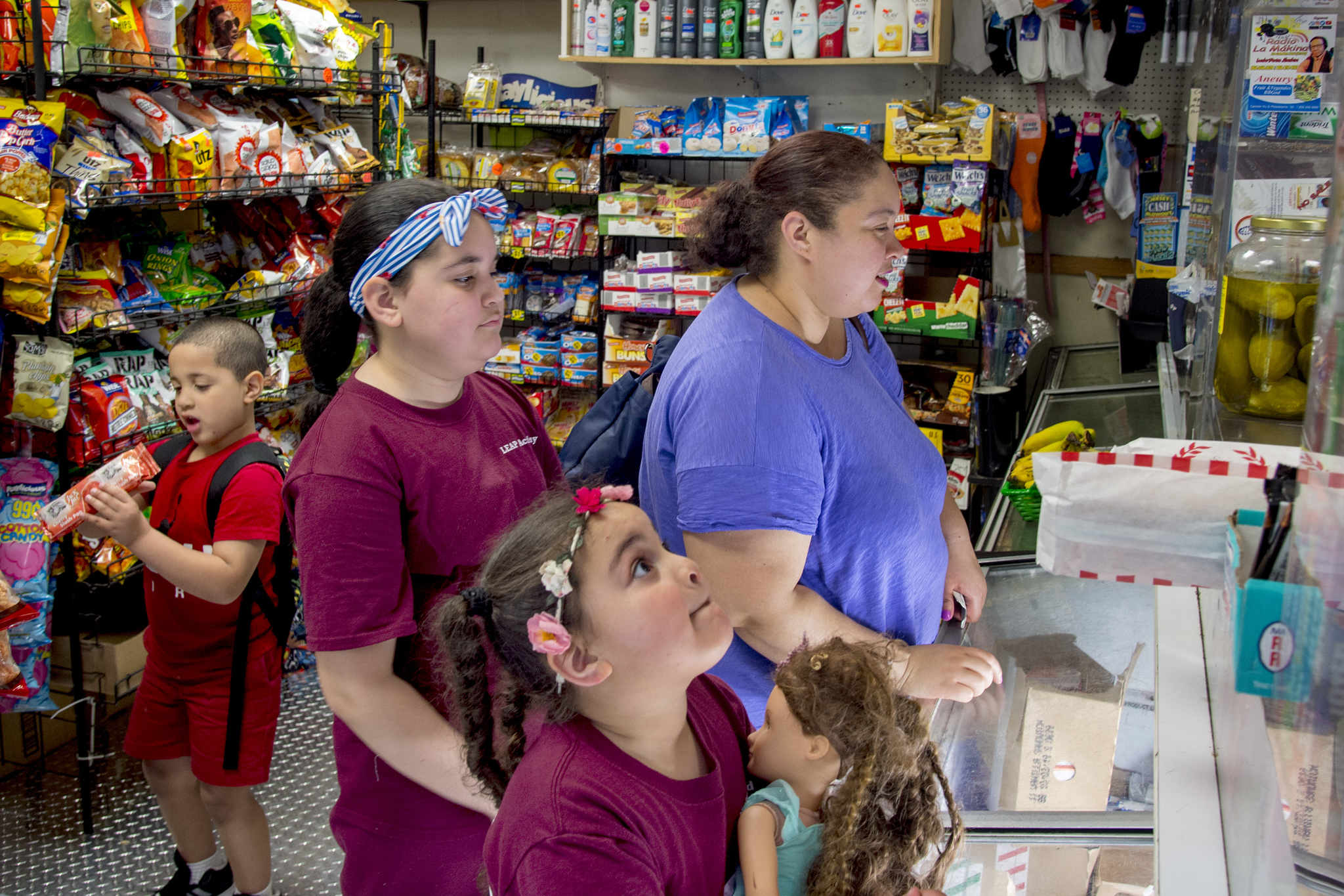 Veronica Ramirez stops at corner store with her children after picking son up at end of his day at Head Start. He iis one of 3,000 students who selected schools for the coming year through Camden Enrollment, a citywide system that lets students apply to nearly any public school in the city with one application.