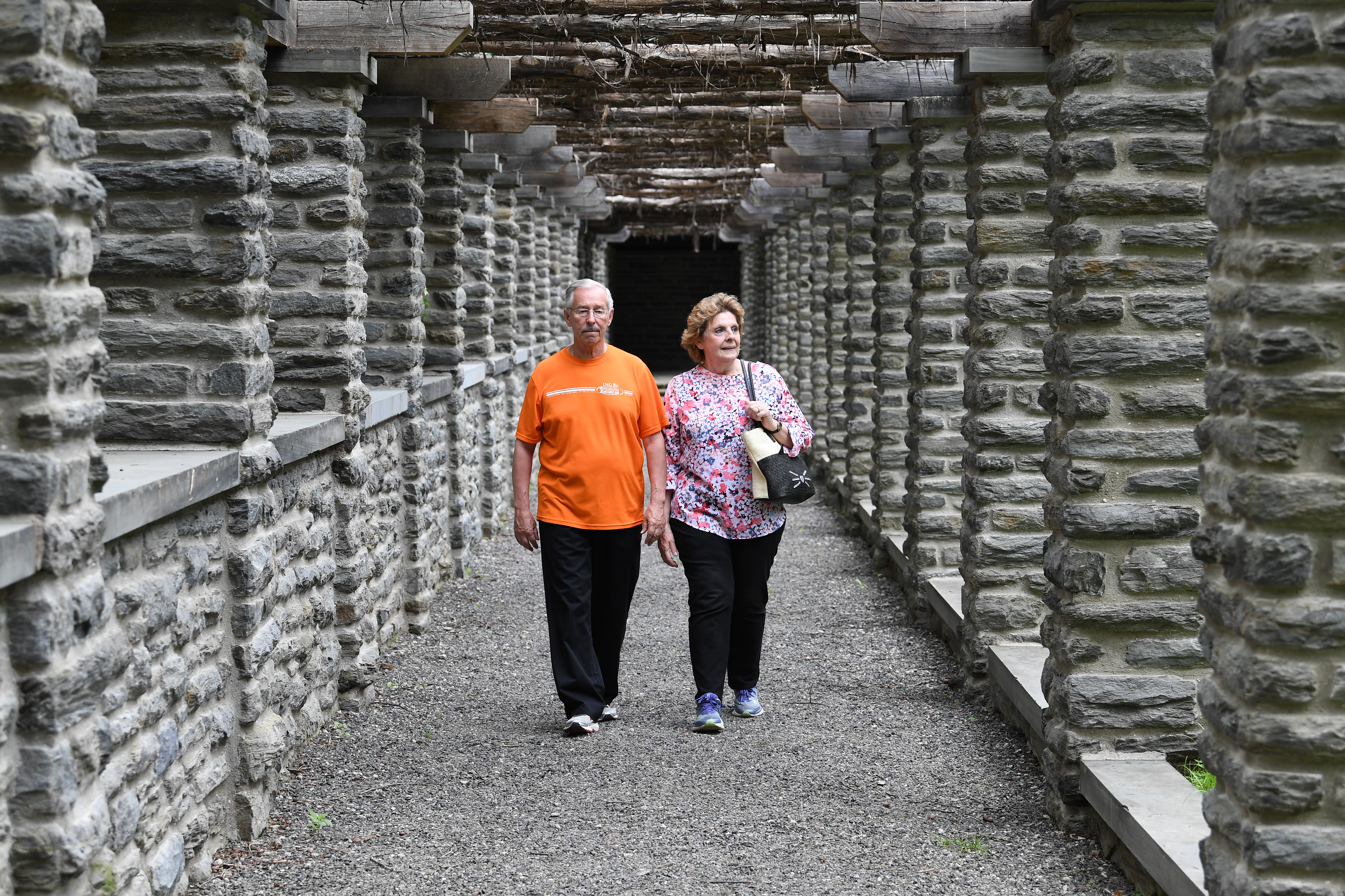 Fran Ingelsby and Renee Ingelsby of Newtown Square walked through this picturesque stone structure at Stoneleigh natural lands garden on Wednesday, May 30, 2018.