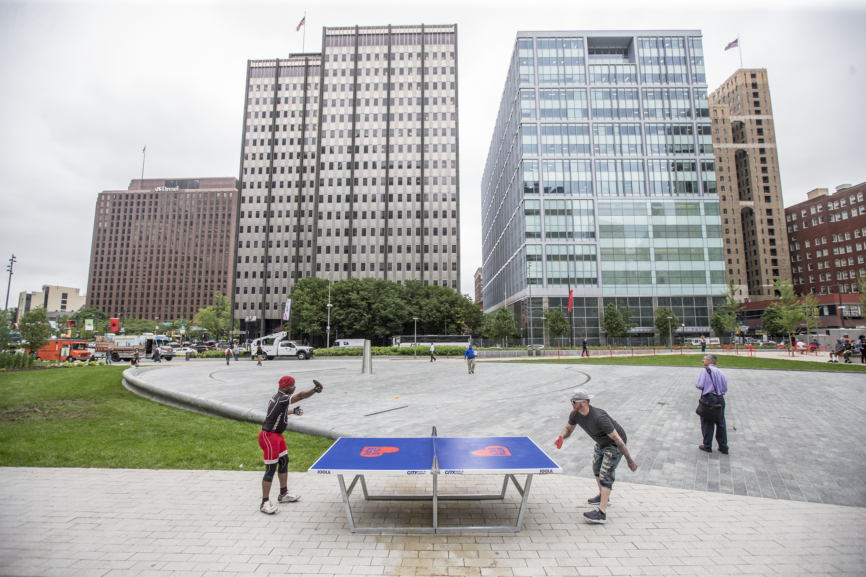 A pair play a game of ping pong at one of the two new ping pong tables, complete with balls and paddles, at LOVE Park on May 30, 2018.