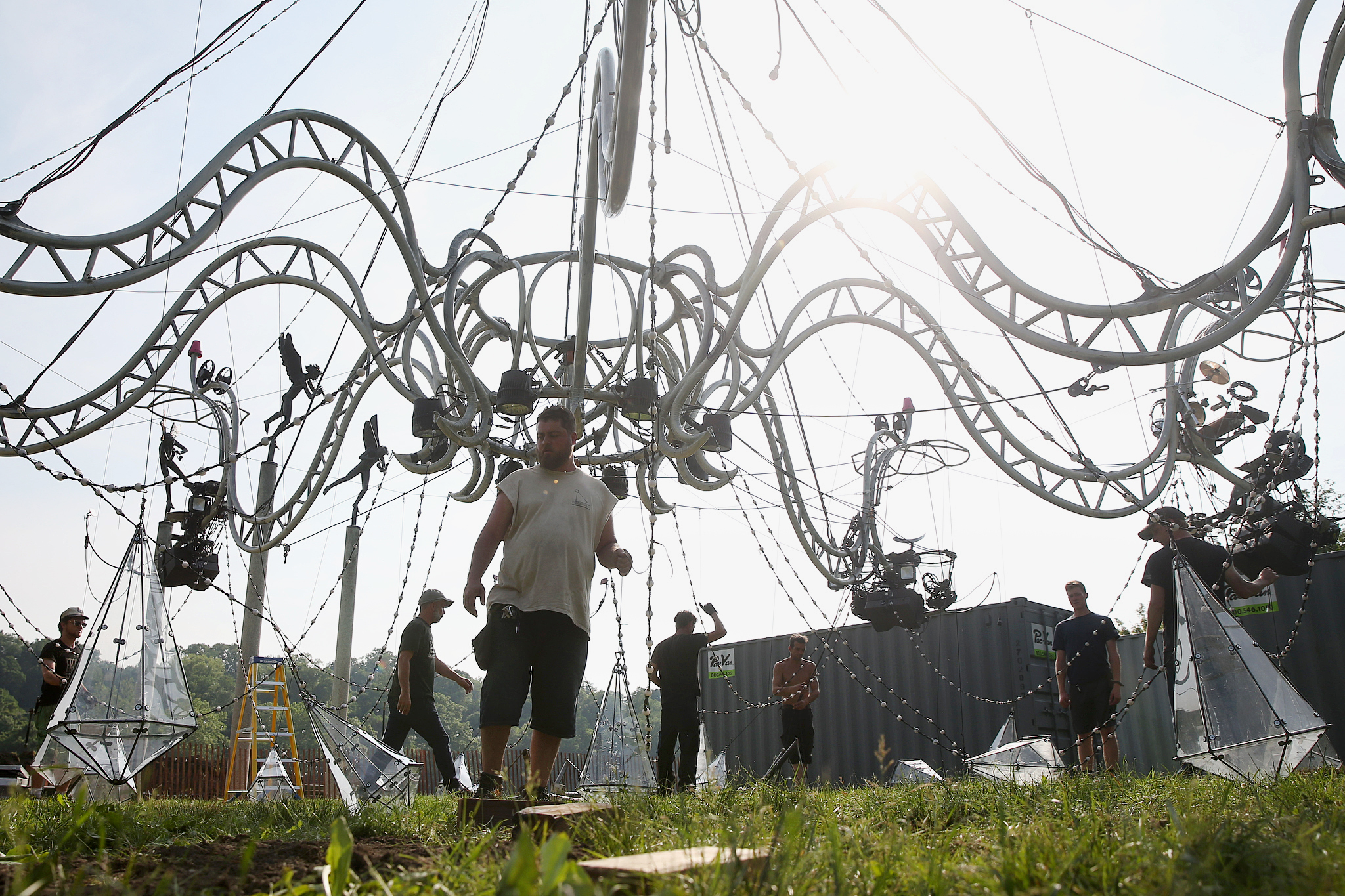 Workers raise the Cristal Palace human chandelier during a test along Kelly Drive near Fountain Green Drive in Philadelphia on Tuesday, May 29, 2018. French performance troupe Transe Express will perfor on human chandelier as part of this year´s Philadelphia International Festival of the Arts. TIM TAI / Staff Photographer