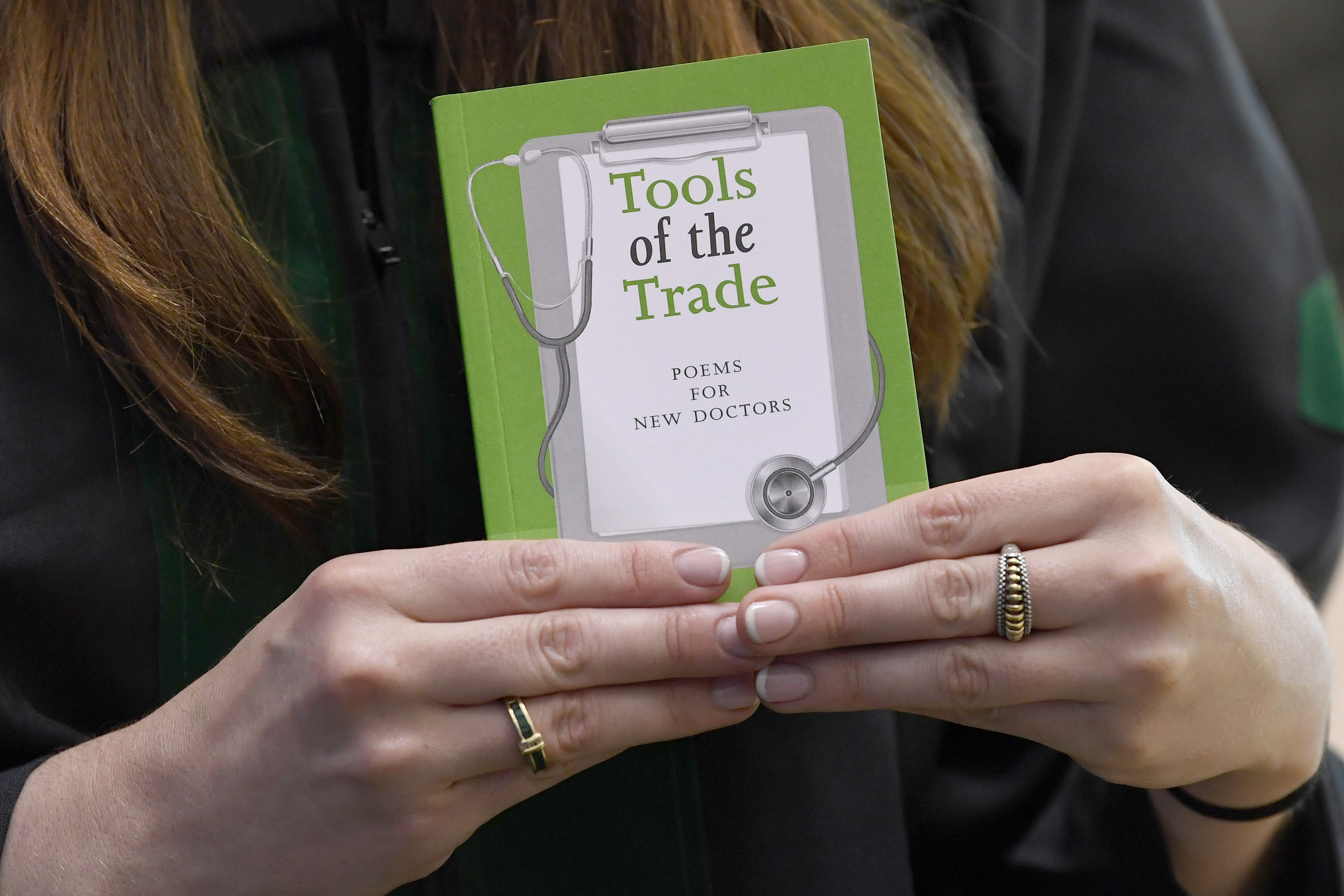 The book, Tools of the Trade: Poems for New Doctors, was presented to all graduates-to-be at commencement practice Wednesday.