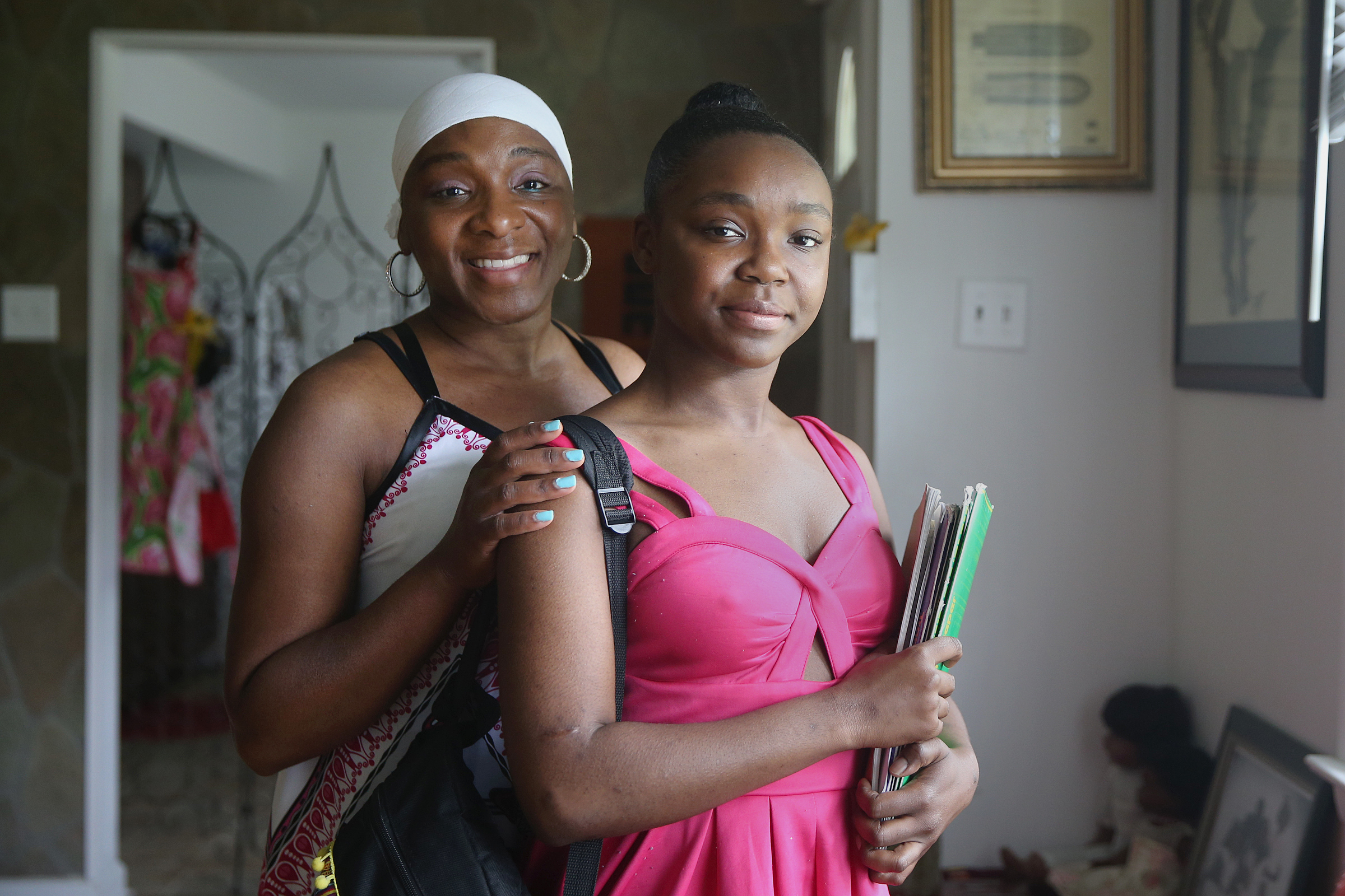 Rhapsody Taylor, right, a junior studying dance at University of the Arts, stands for a portrait with her mother, Shawnta Taylor, at their Pennsauken, N.J., home on Tuesday, May 29, 2018.