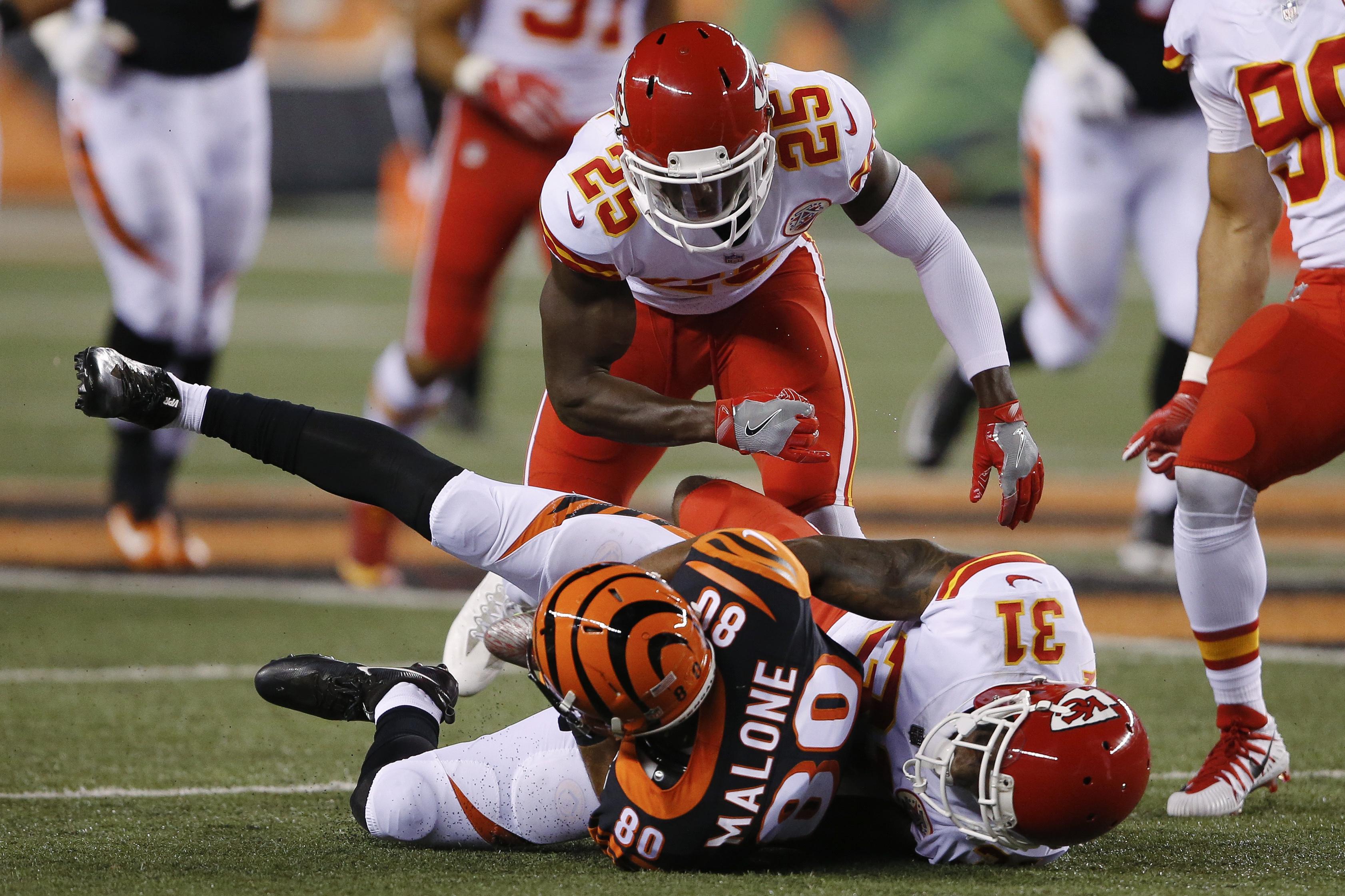 Chiefs cornerback DeVante Bausby (31) tackling Bengals wide receiver Josh Malone (80) during a preseason game last August.