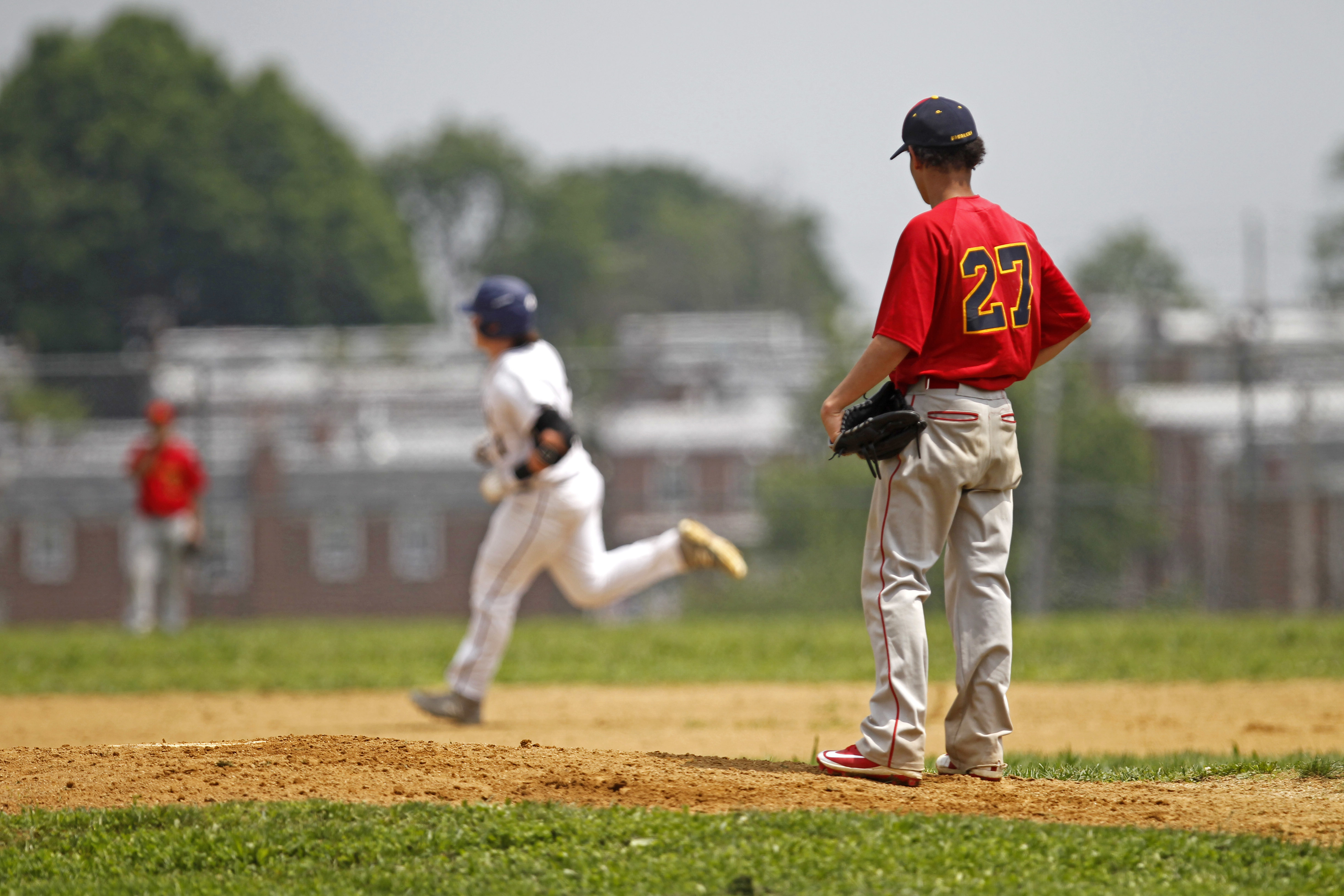 Frankford pitchers Abenego Santos watches Brian Schaub round the bases after his first-inning home run.