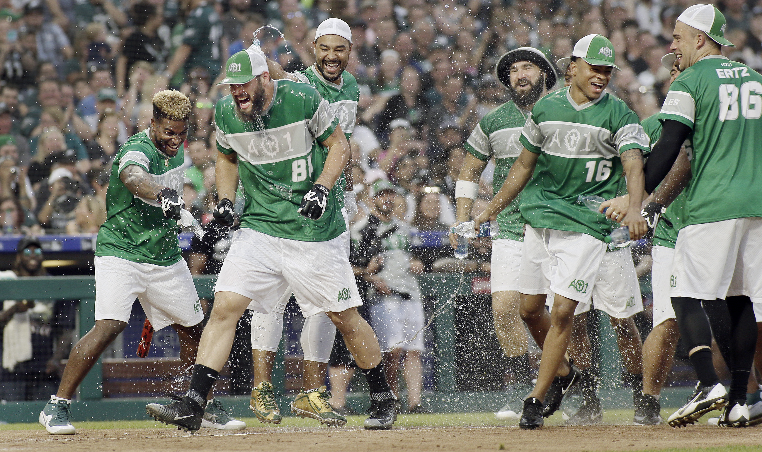 Eagles rookie tight end Dallas Goedert gets soaked by teammates after he hit a home run during Carson Wentz´s charity softball game at Citizens Bank Park.