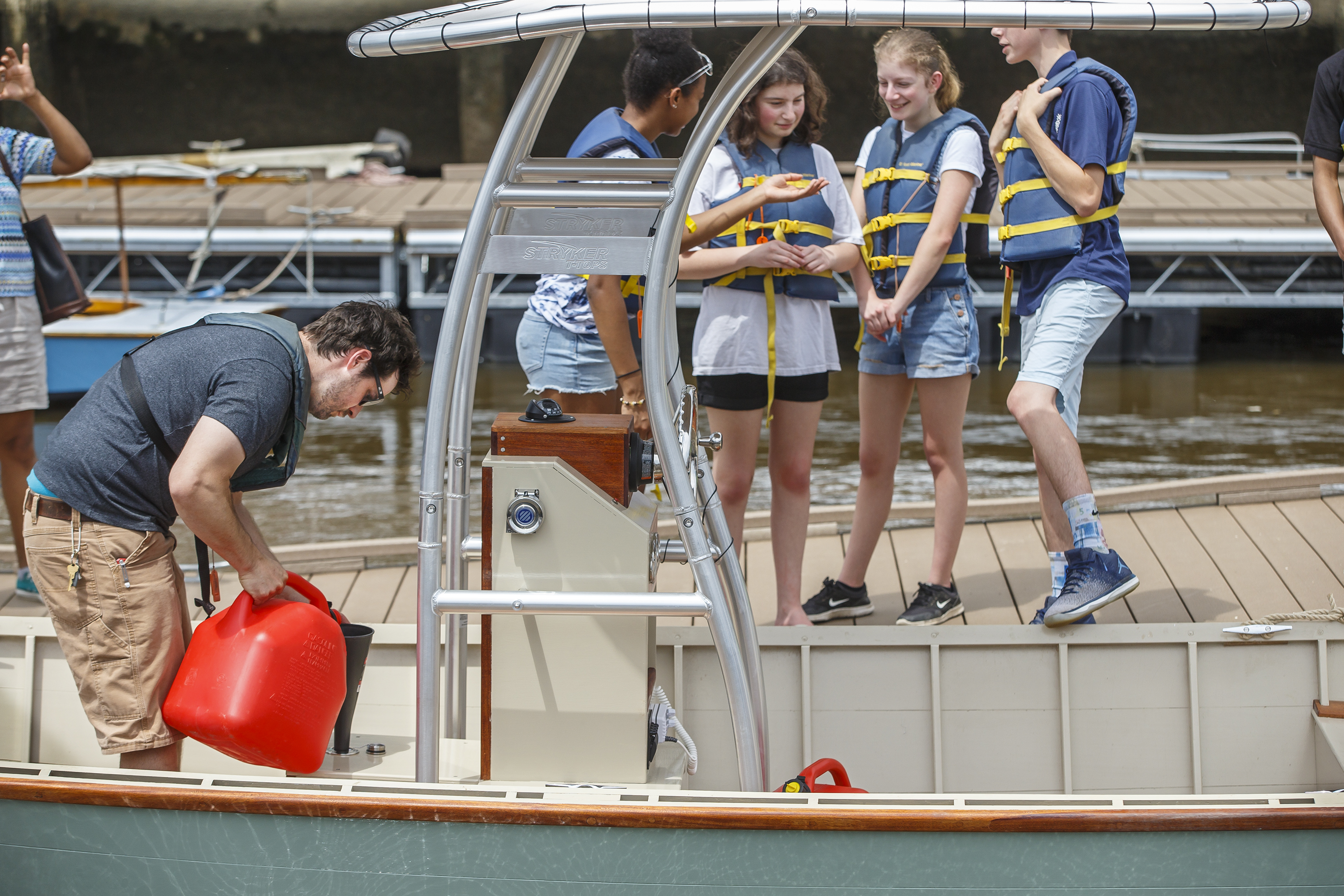 As the high school students, right, who help build the JAWN, a Garvery boat, instructor Dave Dormond, left, from the Independent Seaport Museum, has to fill the tanks up with gas before he can take them out for a spin on the Delaware River on Saturday June 2, 2018.