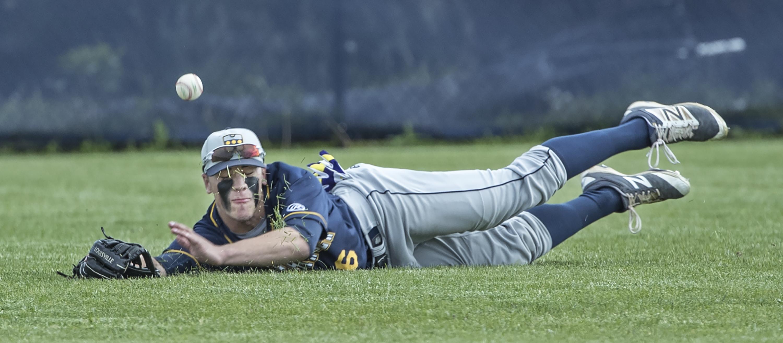 Penn Charter's Mike Siani dives for a ball hit by a Malvern Prep player last season.