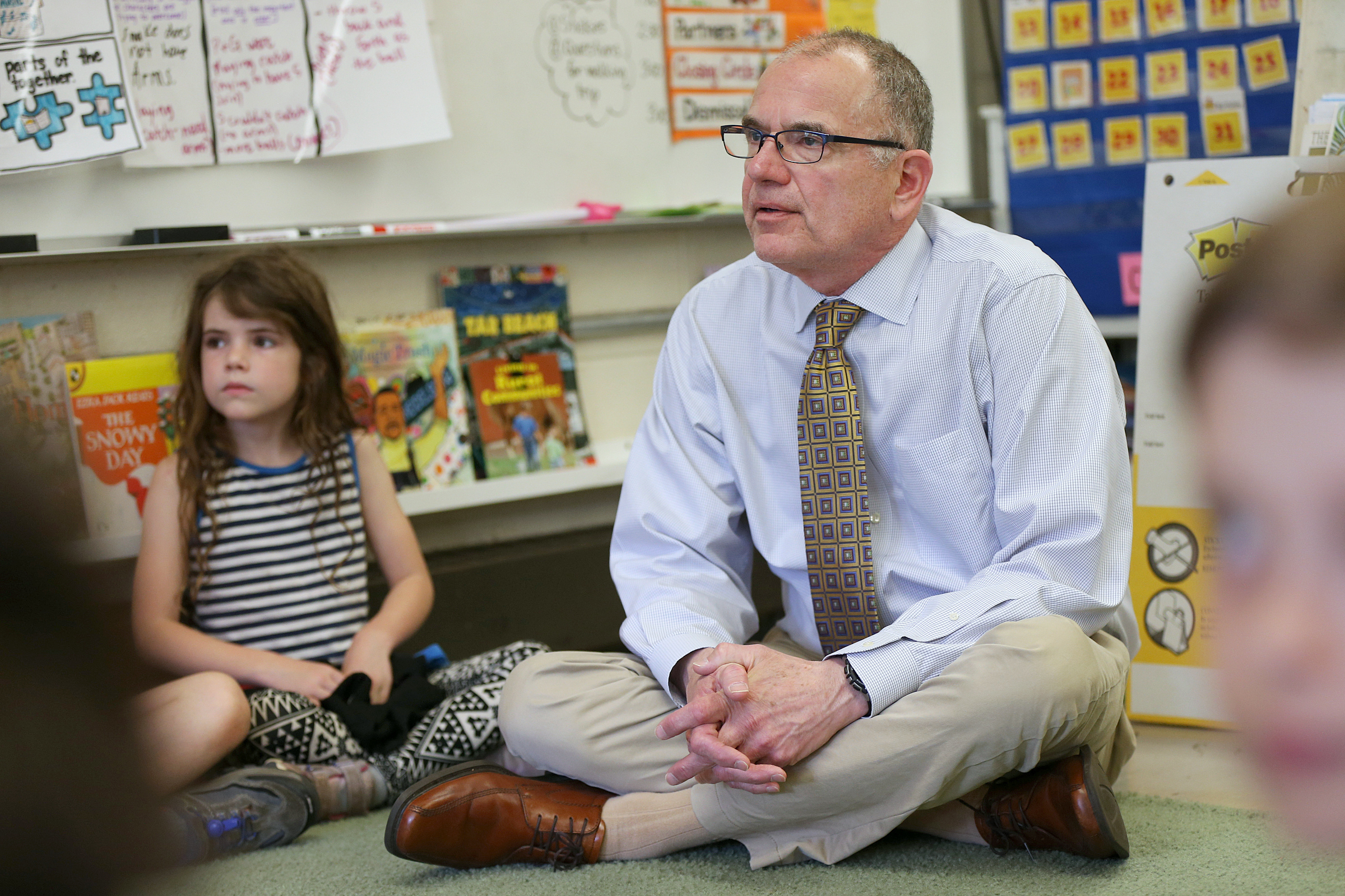 Craig Stevens, school psychologist and director of student support services, participates in a Feedback program session with first-graders at Germantown Friends School.