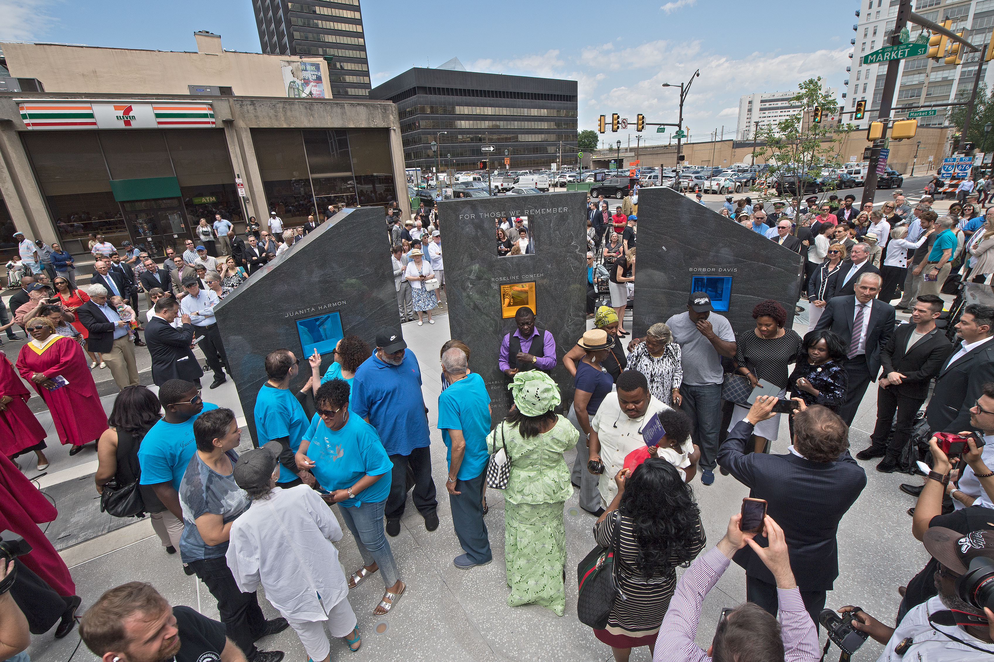 Family members and friends gather after the dedication of the memorial park honoring those killed in the Salvation Army building collapse at 22nd and Market Streets on the fifth anniversary of the tragedy Tuesday, June 5, 2018.