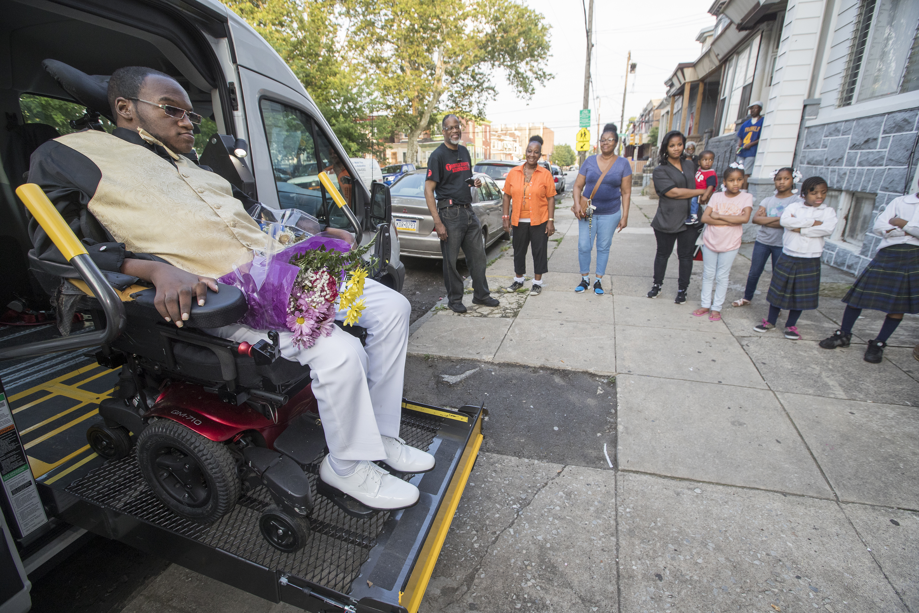Lariq Byrd, left, was shot and paralyzed the day after Christmas in 2015. He is going to the Gratz High School senior prom with Daamiera Carr and with the help of Magee Rehab, which hooked him up with a wheelchair accessible van on June 1, 2018. He arrives in the van at his date's home. CHARLES FOX / Staff Photographer